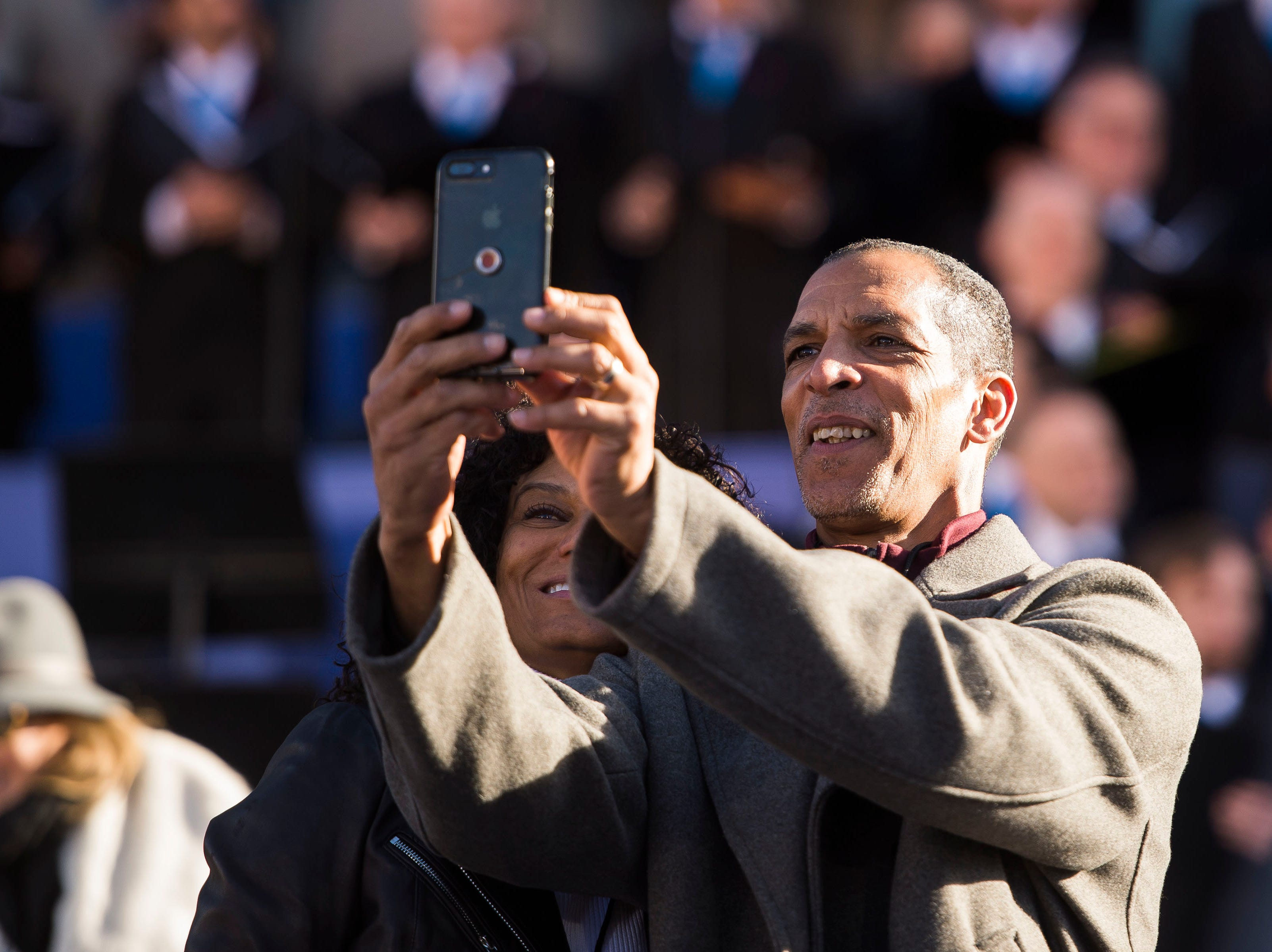 Simply Pure, a Denver dispensary, CEO Wanda James, left, and COO Scott Durrah take a selphie before the inauguration of Colorado State Governor Jared Polis on Tuesday, Jan. 8, 2019, in front of the Colorado State Capital building in Denver, Colo.