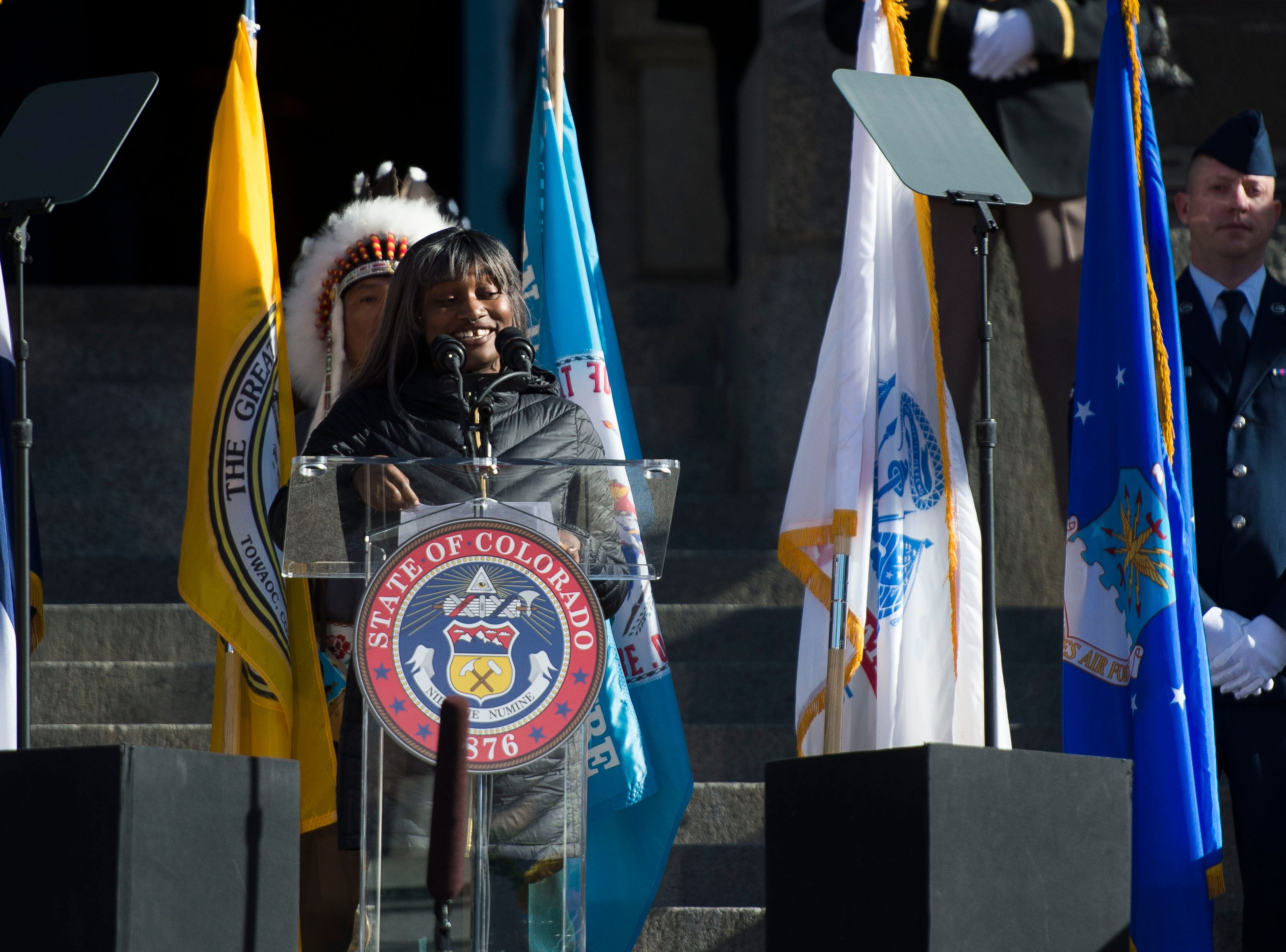 Poet Toluwanimi Obiwole recites a poem during the inauguration of Colorado State Governor Jared Polis on Tuesday, Jan. 8, 2019, in front of the Colorado State Capital building in Denver, Colo.
