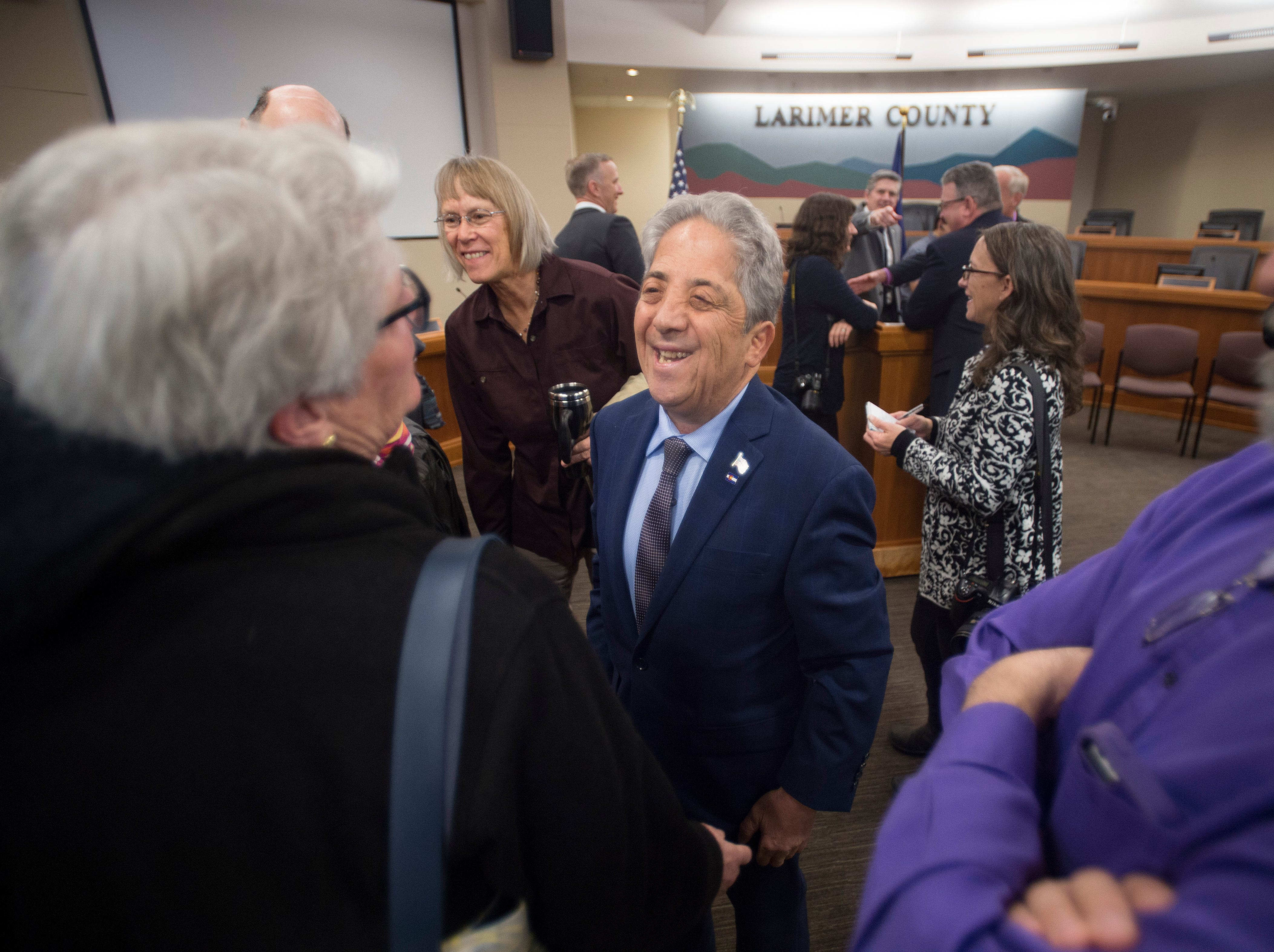 Larimer County Commissioner John Kefalas talks with supporters after being sworn in at Larimer County Courthouse on Tuesday, January 8, 2019.