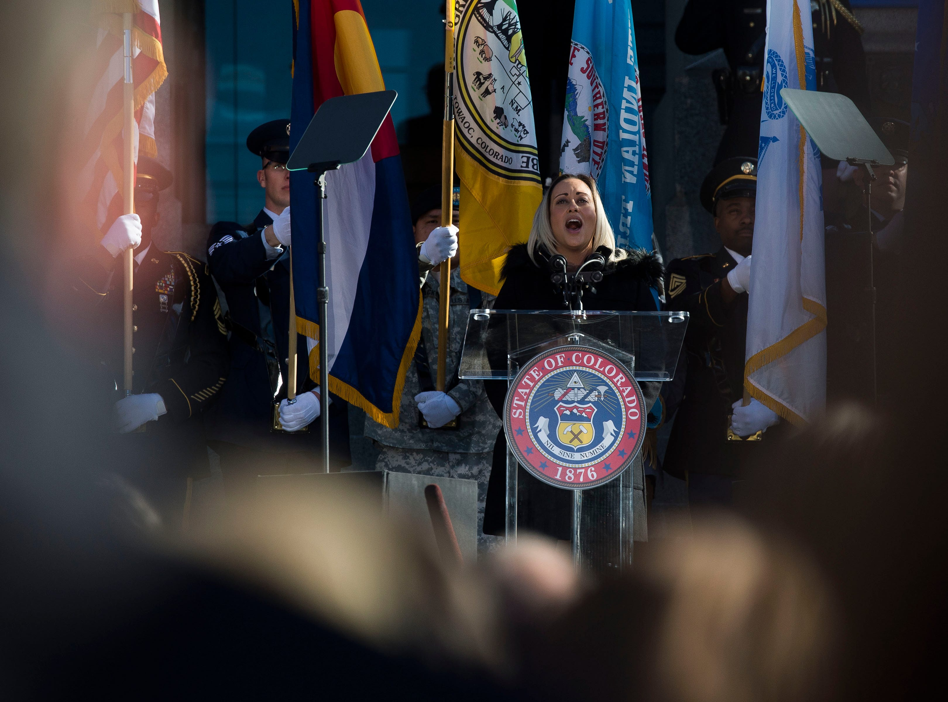 Andrea Neidig performs the National Anthem during the inauguration of Colorado State Governor Jared Polis on Tuesday, Jan. 8, 2019, in front of the Colorado State Capital building in Denver, Colo.
