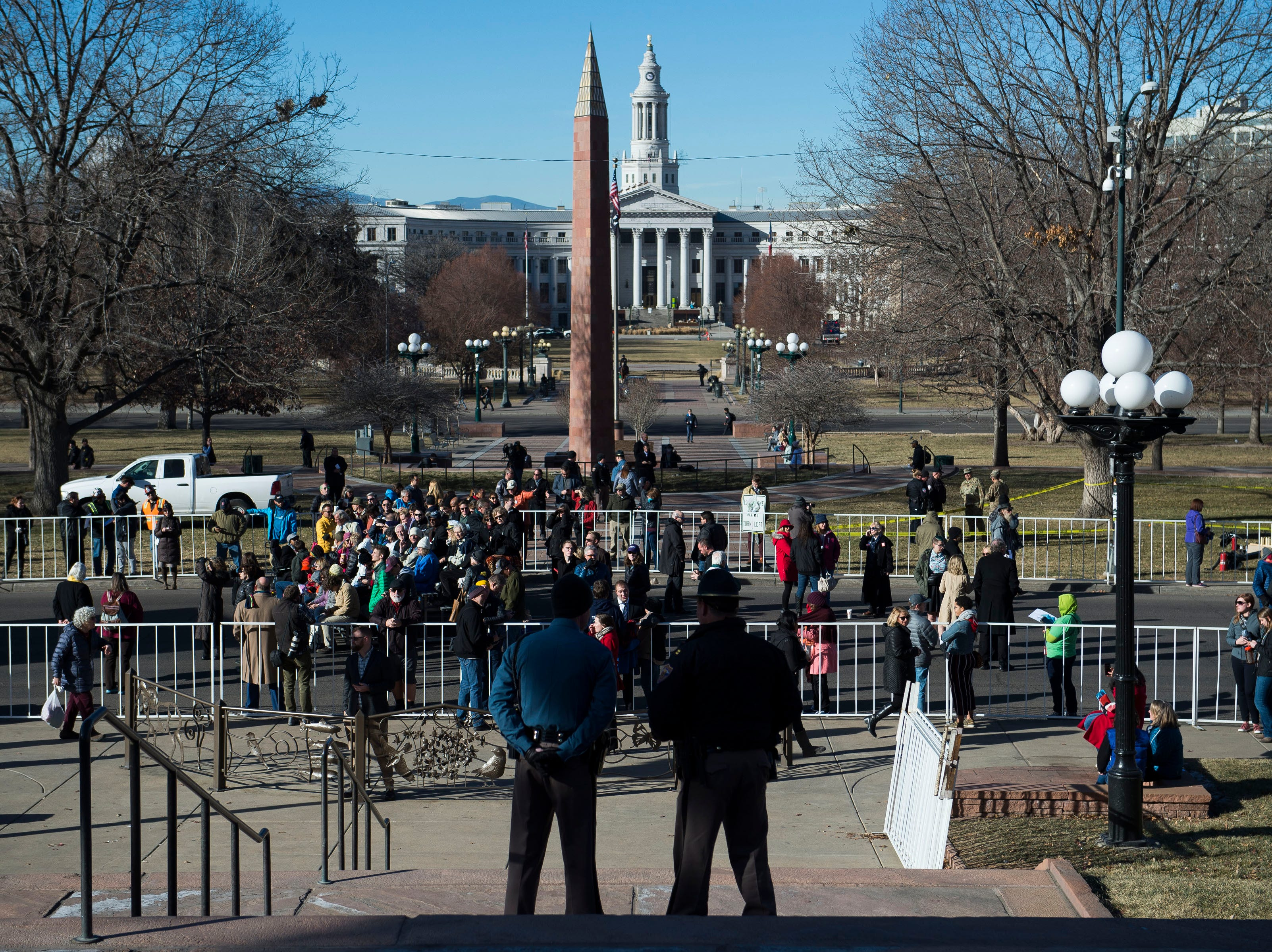 A small crowd begins to gather in a cordoned-off area of Lincoln Street before the inauguration of Colorado State Governor Jared Polis on Tuesday, Jan. 8, 2019, in front of the Colorado State Capital building in Denver, Colo.