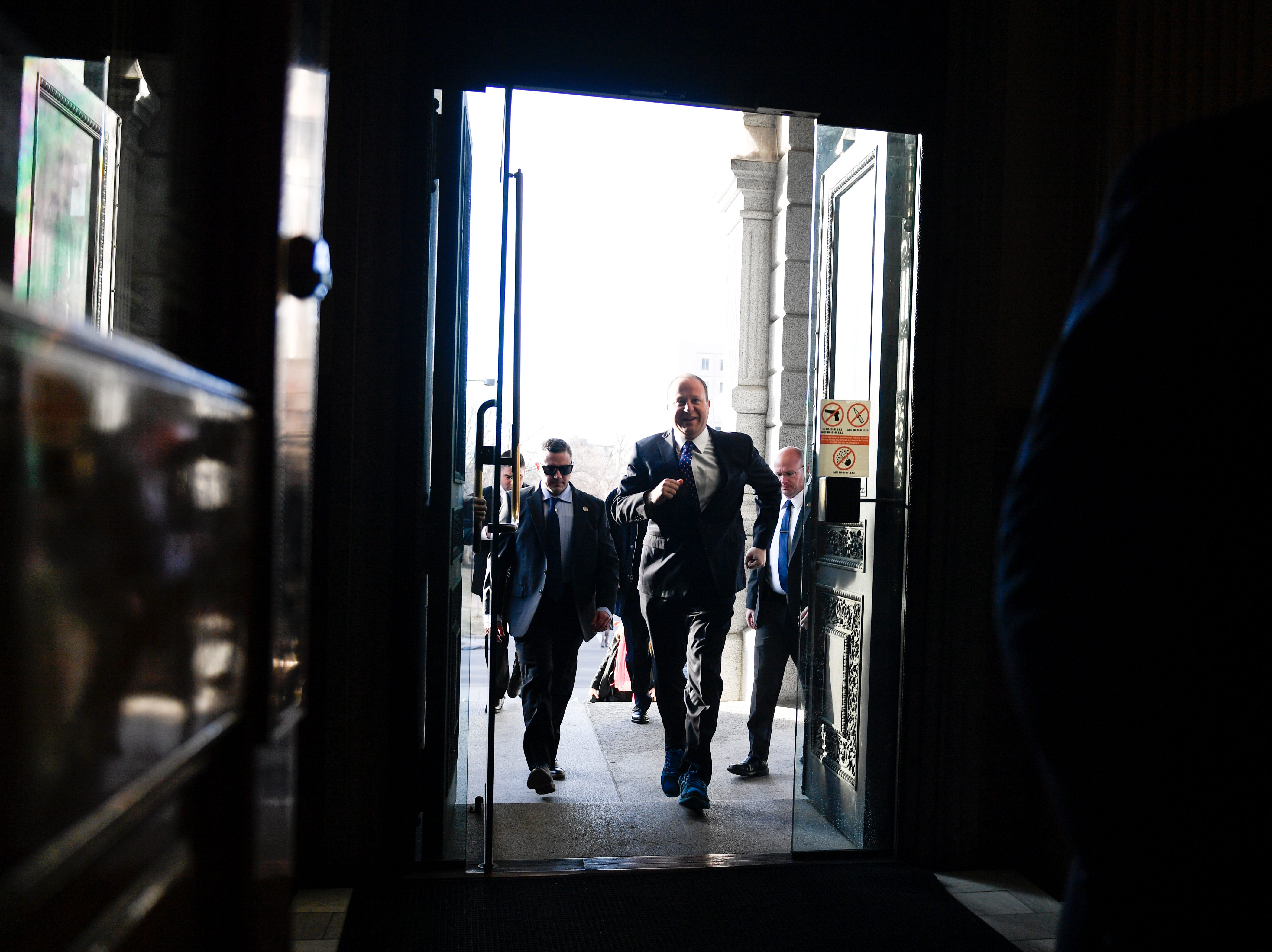 DENVER, CO - JANUARY 8: Colorado Governor elect Jared Polis jogs through the doorway as he arrives on scene before his inauguration at the Colorado State Capitol on Tuesday, January 8, 2019. (Photo by AAron Ontiveroz/The Denver Post/Pool)