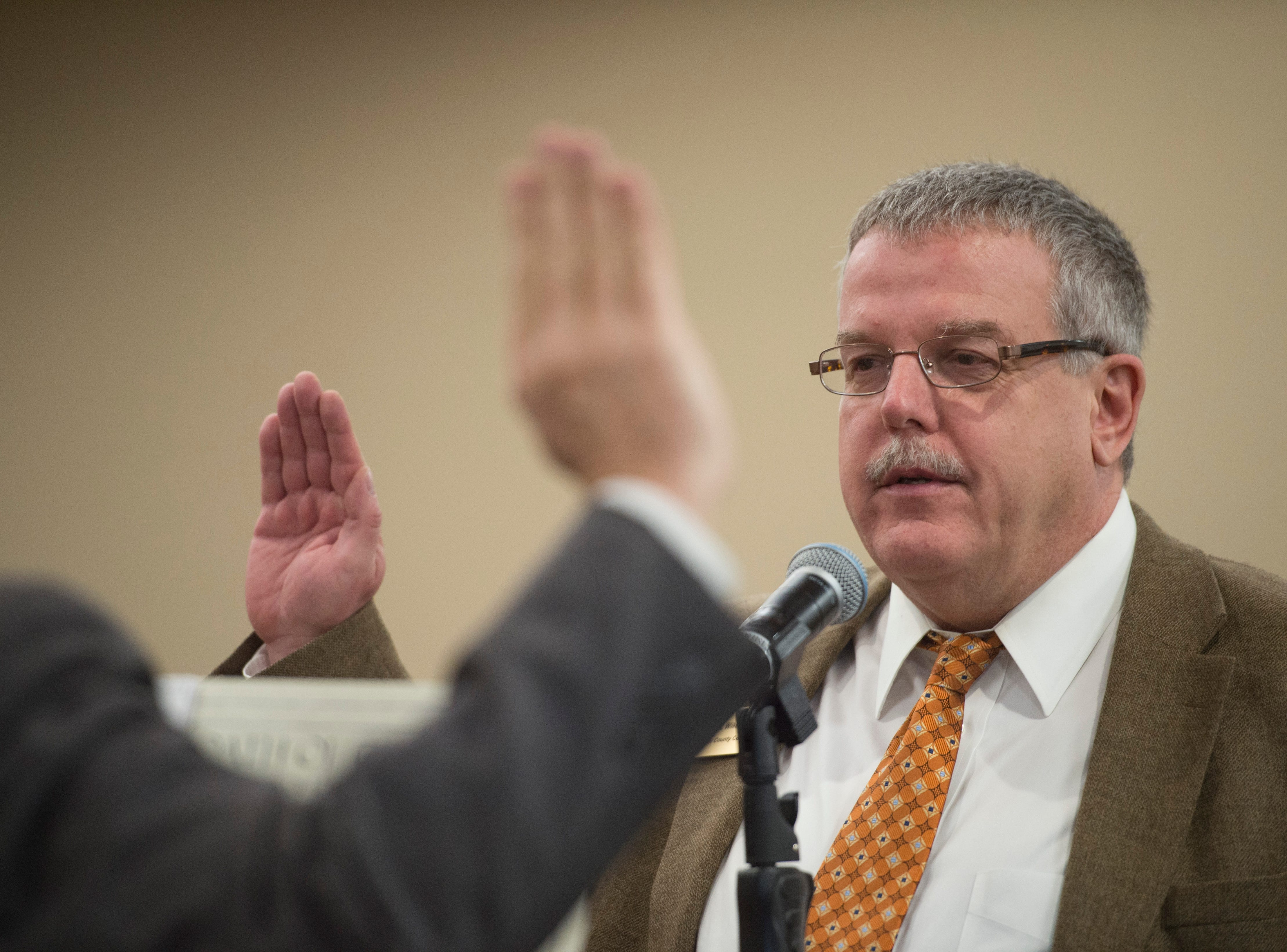 Larimer County Coroner James Wilkerson is sworn in for another term at the Larimer County Courthouse on Tuesday, January 8, 2019.