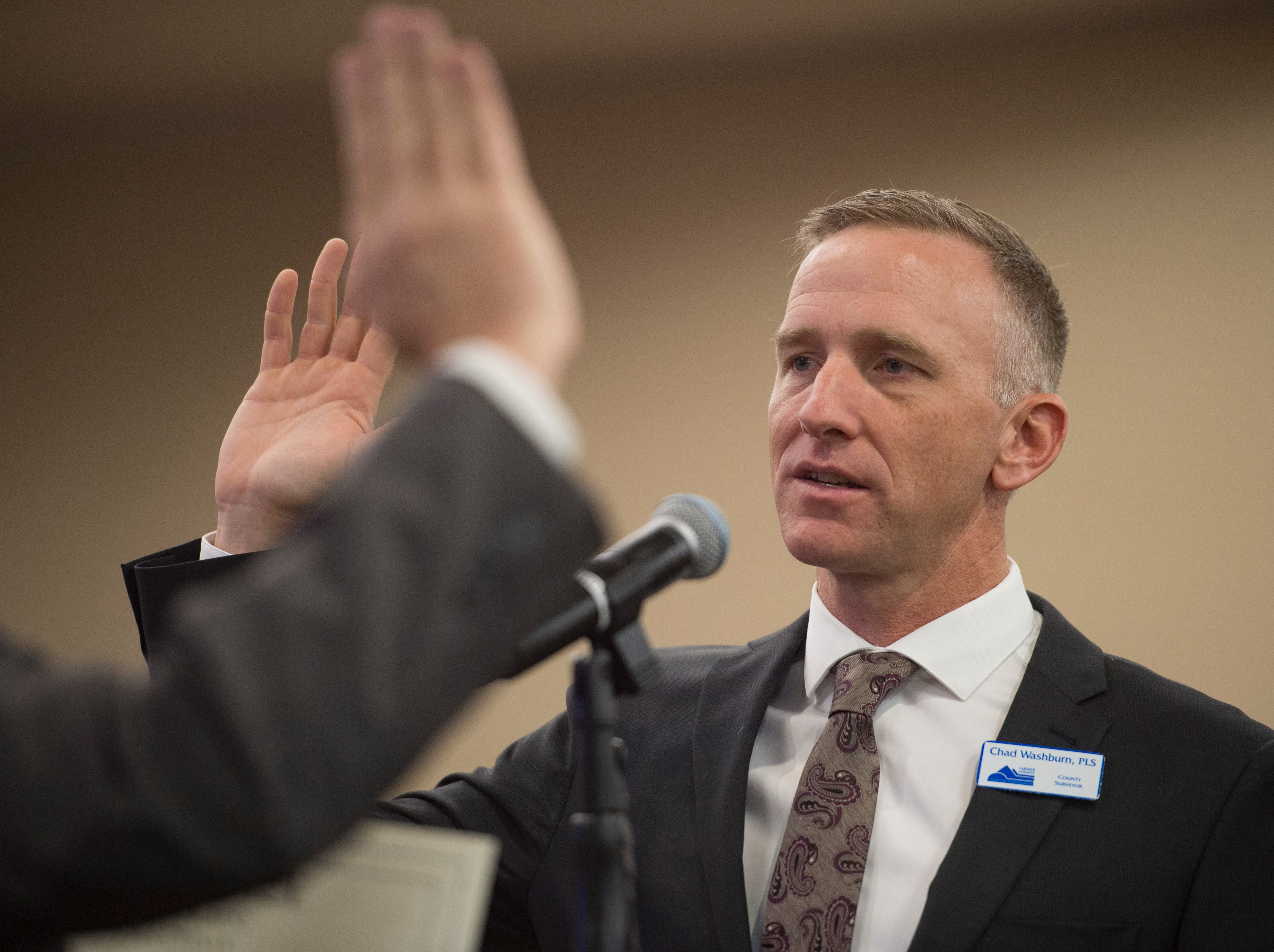 Larimer County Surveyor Chad Washburn is sworn in for another term at the Larimer County Courthouse on Tuesday, January 8, 2019.
