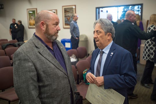 Outgoing Larimer County Commissioner Sean Dougherty talks with John Kefalas, who was sworn in as commissioner at the Larimer County Courthouse Offices Building in Fort Collins on Tuesday.