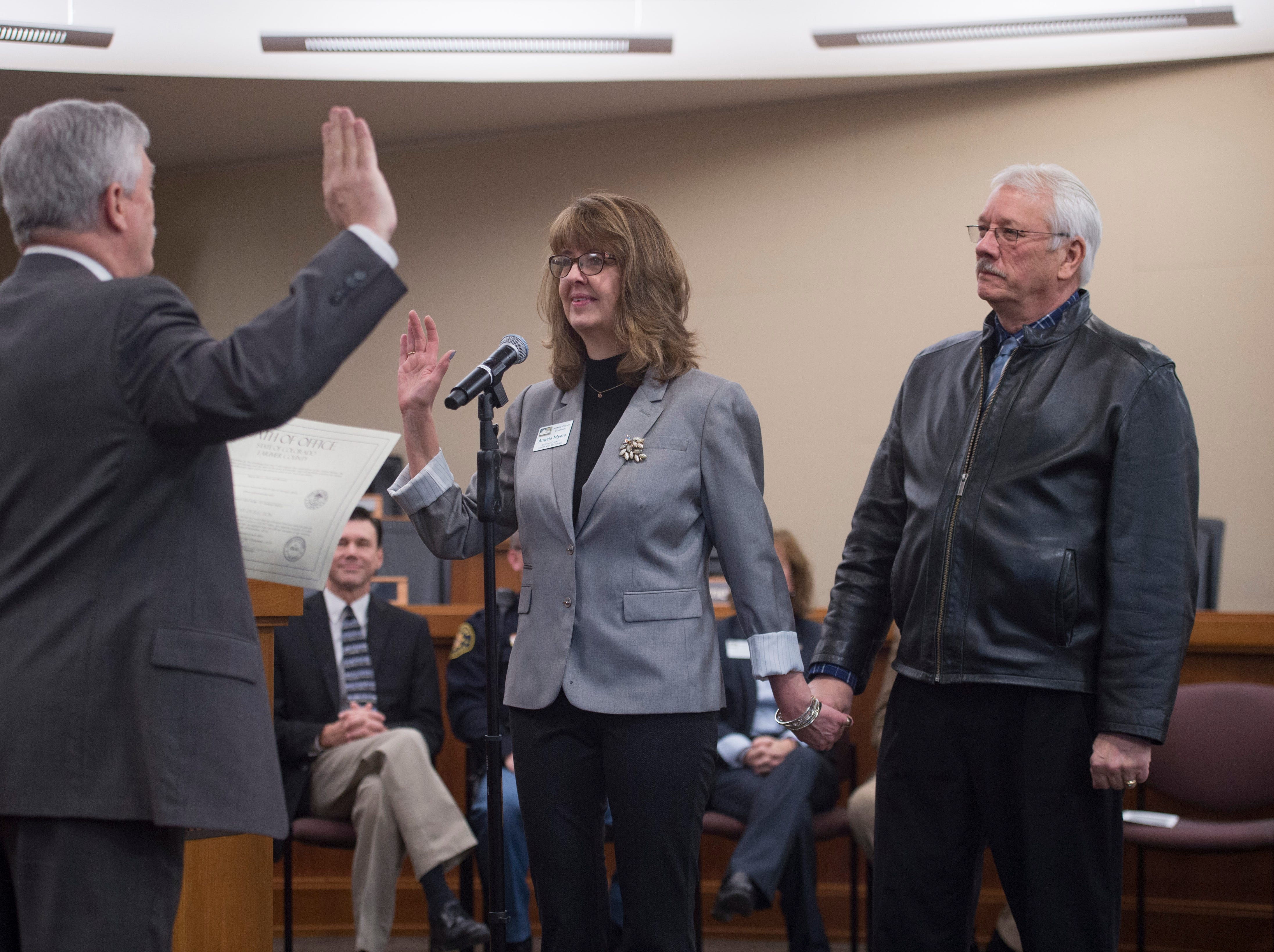 Larimer County Clerk Angela Meyers is sworn in for another term with her husband, Gary, at her side at the Larimer County Courthouse on Tuesday, January 8, 2019.