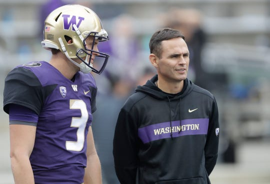 Matt Lubick, Washington's co-offensive coordinator at the time, stands with quarterback Jake Browning before a Sept, 29, 2018, game against BYU in Seattle. Lubick accepted a job as Nebraska's new offensive coordinator under coach Scott Frost on Friday