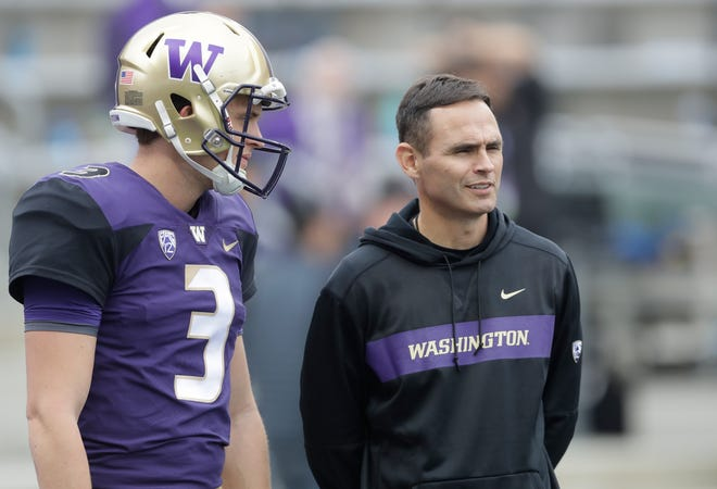 Matt Lubick, left, Washington's co-offensive coordinator and receivers coach for the past two seasons, talks to quarterback Jake Browning before a Sept. 29 game against BYU in Seattle. Lubick, the oldest son of legendary CSU football coach Sonny Lubick, is coming back to Fort Collins to work for Canvas Credit Union as a liaison to oversee its new partnership with Colorado State University.