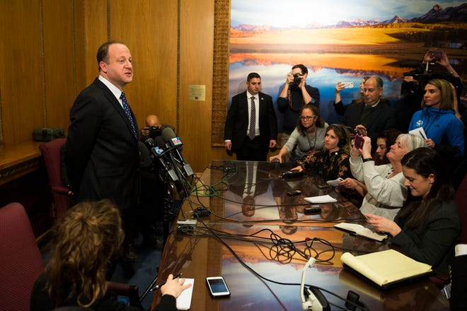 Colorado State Governor Jared Polis talks to members of the media on Tuesday, Jan. 8, 2019, in the Colorado State Capital building in Denver, Colo.