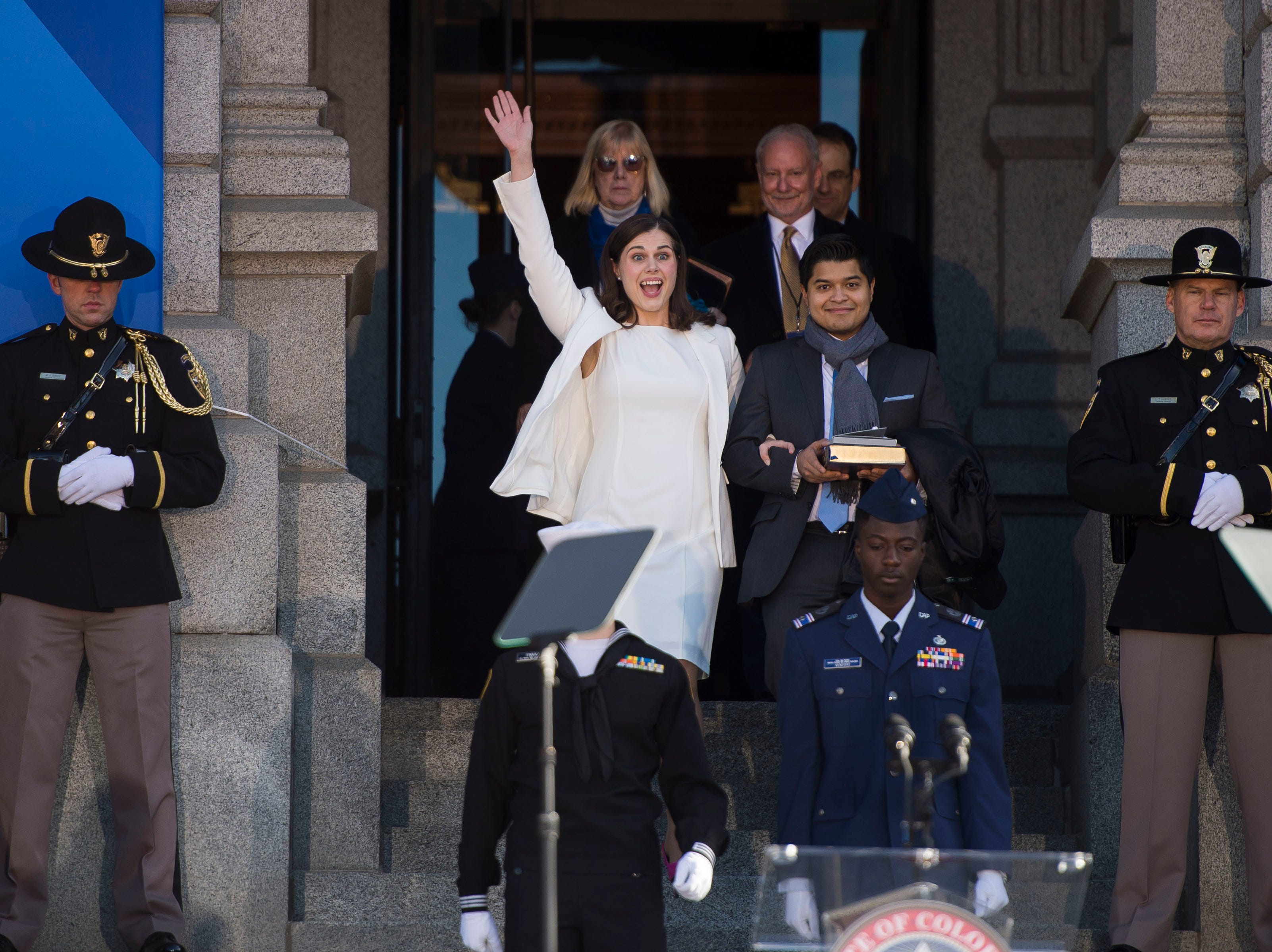 Colorado Secretary of State Jena Griswold waves to the crowd as she walks down the steps of the capital building before the inauguration of Colorado State Governor Jared Polis on Tuesday, Jan. 8, 2019, in front of the Colorado State Capital building in Denver, Colo.
