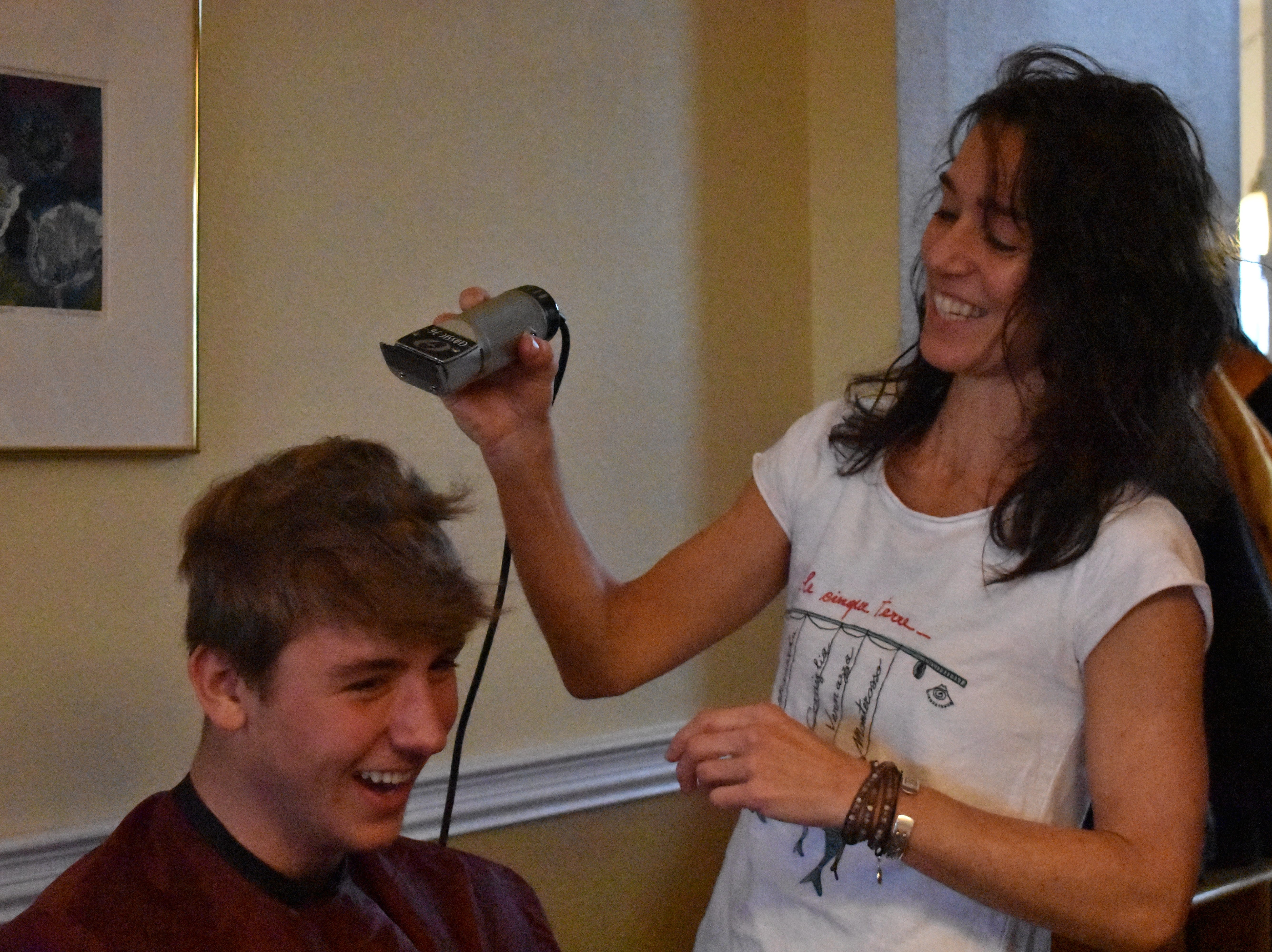 Margaret Urynowicz gets ready to shave son Joe's head in the family's Fort Collins house Dec. 31, 2018, in support of teammate Carter Edgerely, who was recently diagnosed with bone cancer.