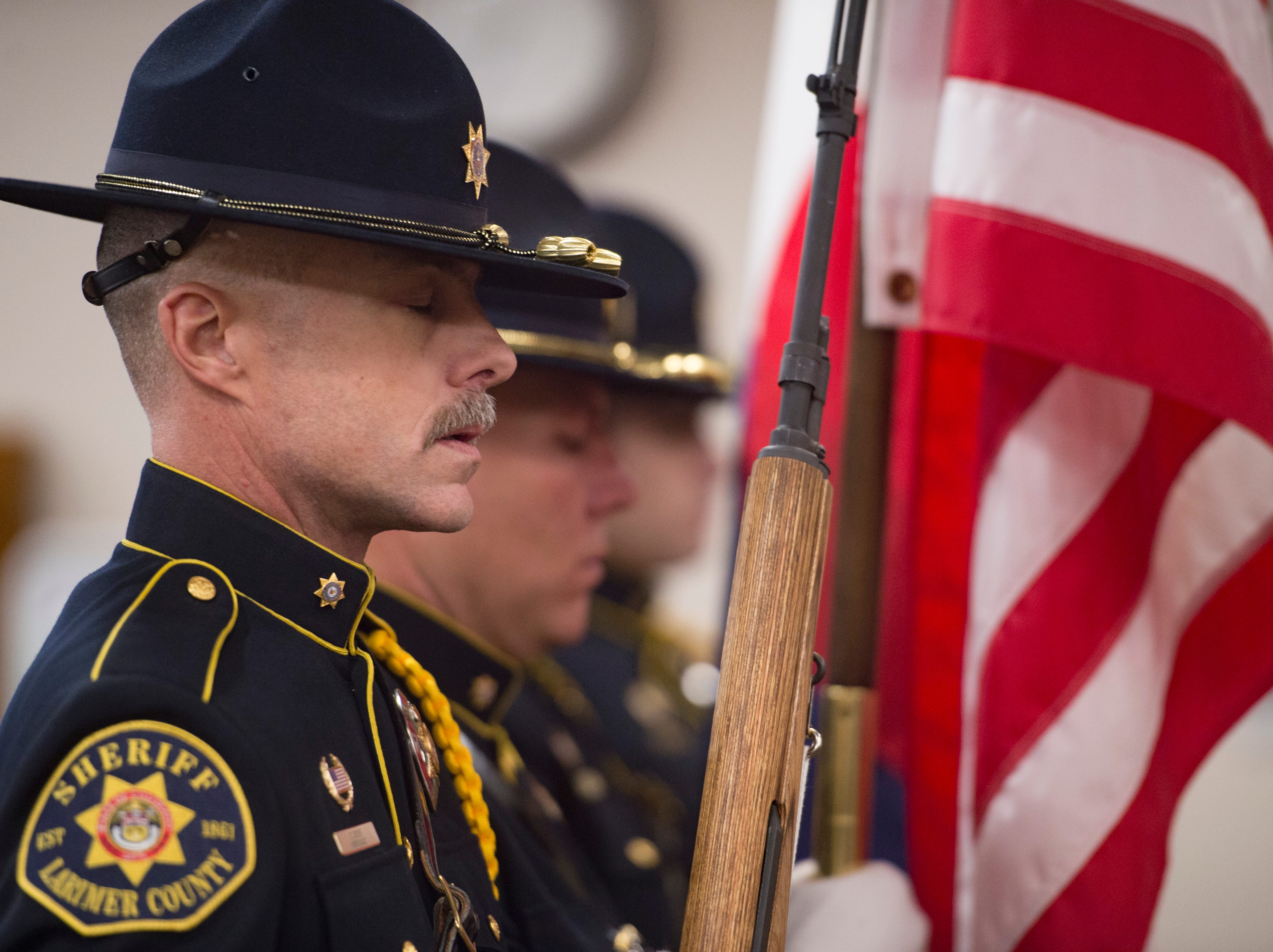 Larimer County Sheriff's Office color guard presents the United States and Colorado state flag before elected officials are sworn in at the Larimer County Courthouse on Tuesday, January 8, 2019.