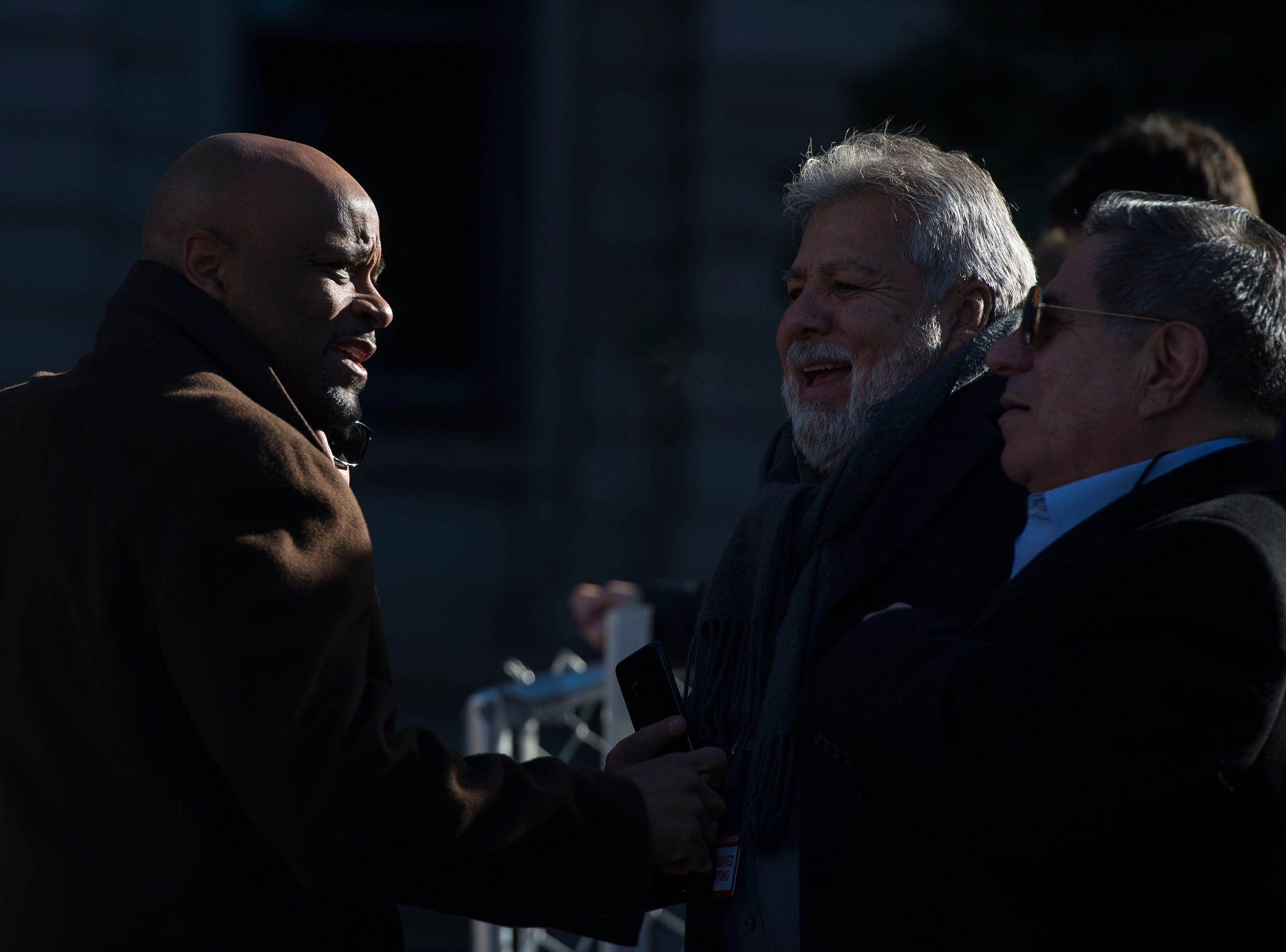 Denver mayor Michael Hancock greets audience members before the inauguration of Colorado State Governor Jared Polis on Tuesday, Jan. 8, 2019, in front of the Colorado State Capital building in Denver, Colo.