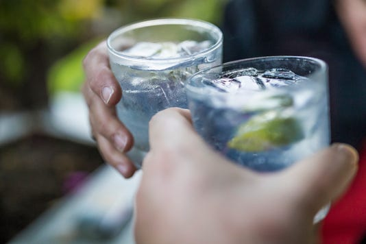 Celebration Concept With Hand Close Up Of A Couple Celebrating The Beginning Of Their Vacations With Each A Gin Tonic