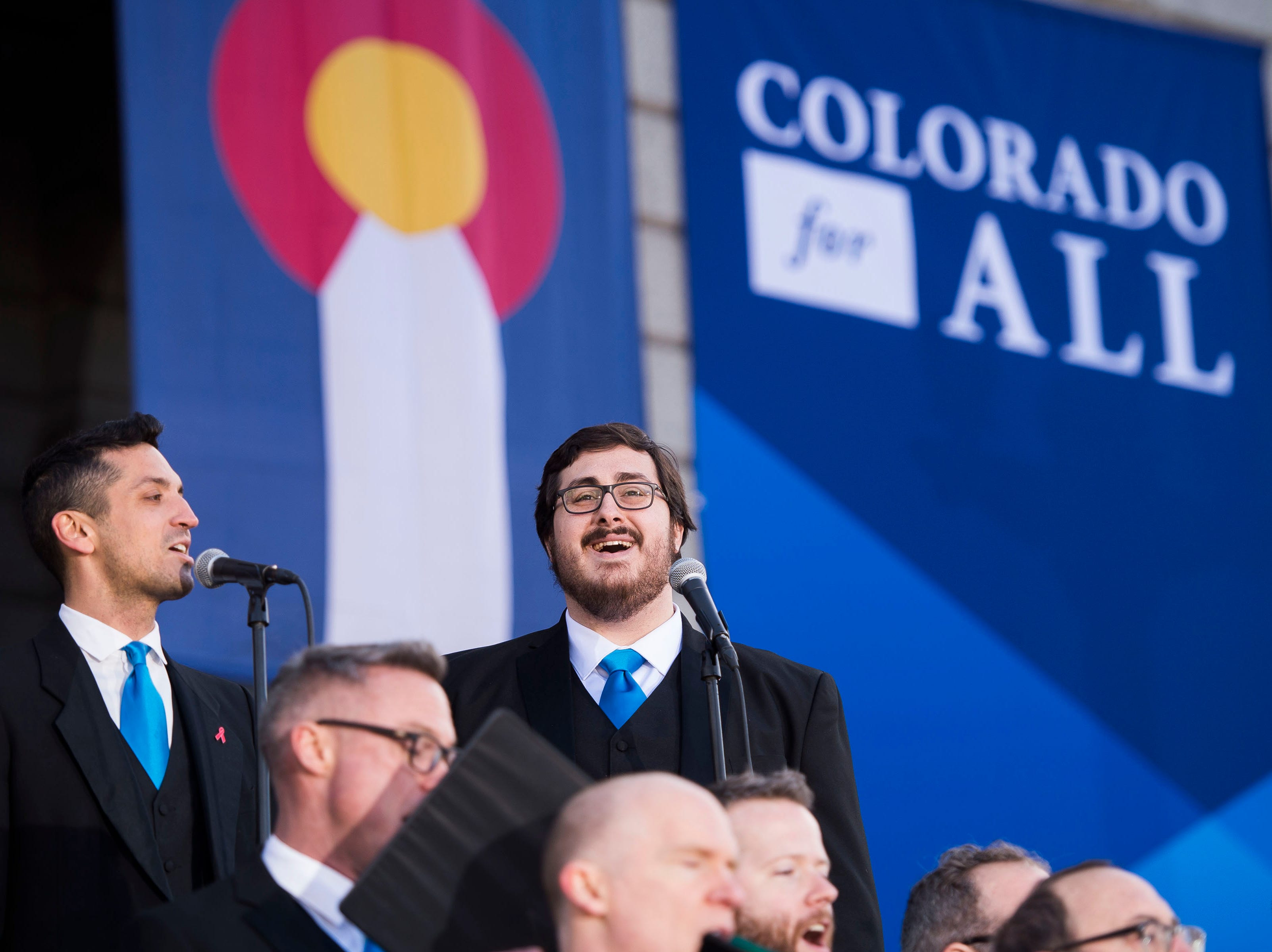 Members of the Denver Gay Men's Chorus perform before the inauguration of Colorado State Governor Jared Polis on Tuesday, Jan. 8, 2019, in front of the Colorado State Capital building in Denver, Colo.