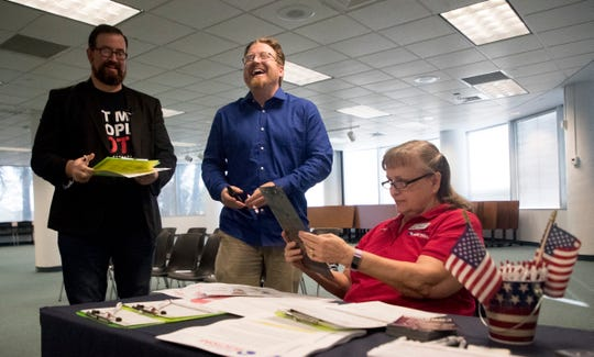 Neil Volz and Lance Wissinger react after registering to vote a the Lee County Elections Office in Fort Myers on Tuesday 1/8/2018. Both are former felons. Former felons who served their sentence are eligible to register to vote on Jan. 8 per the passage of Amendment 4 in November. Both campaigned to get Amendment 4 passed and were some of the first former felons to register.