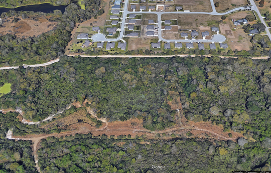 Cedar Trail, the landfill where Fort Myers' sludge will be laid to rest, is surrounded by homes whose residents don't want it there.