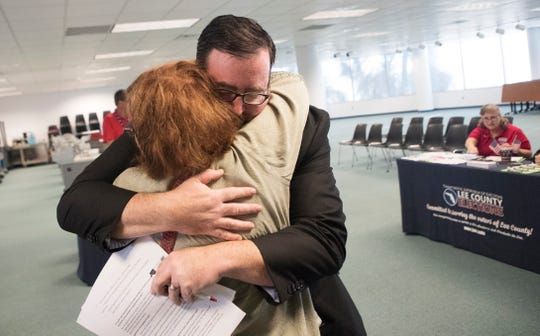 Neil Volz hugs Patricia Racz after registering to vote at the Lee County Elections Office in Fort Myers on Tuesday 1/8/2018. Former felons who served their sentence are eligible to register to vote on Jan. 8 per the passage of Amendment 4 in November. Both campaigned to get Amendment 4 passed and were some of the first former felons to register.