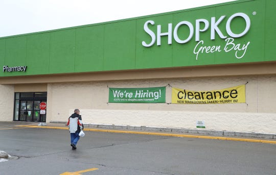 A customer walks toward the Shopko store at 2430 E. Mason Street in Green Bay.