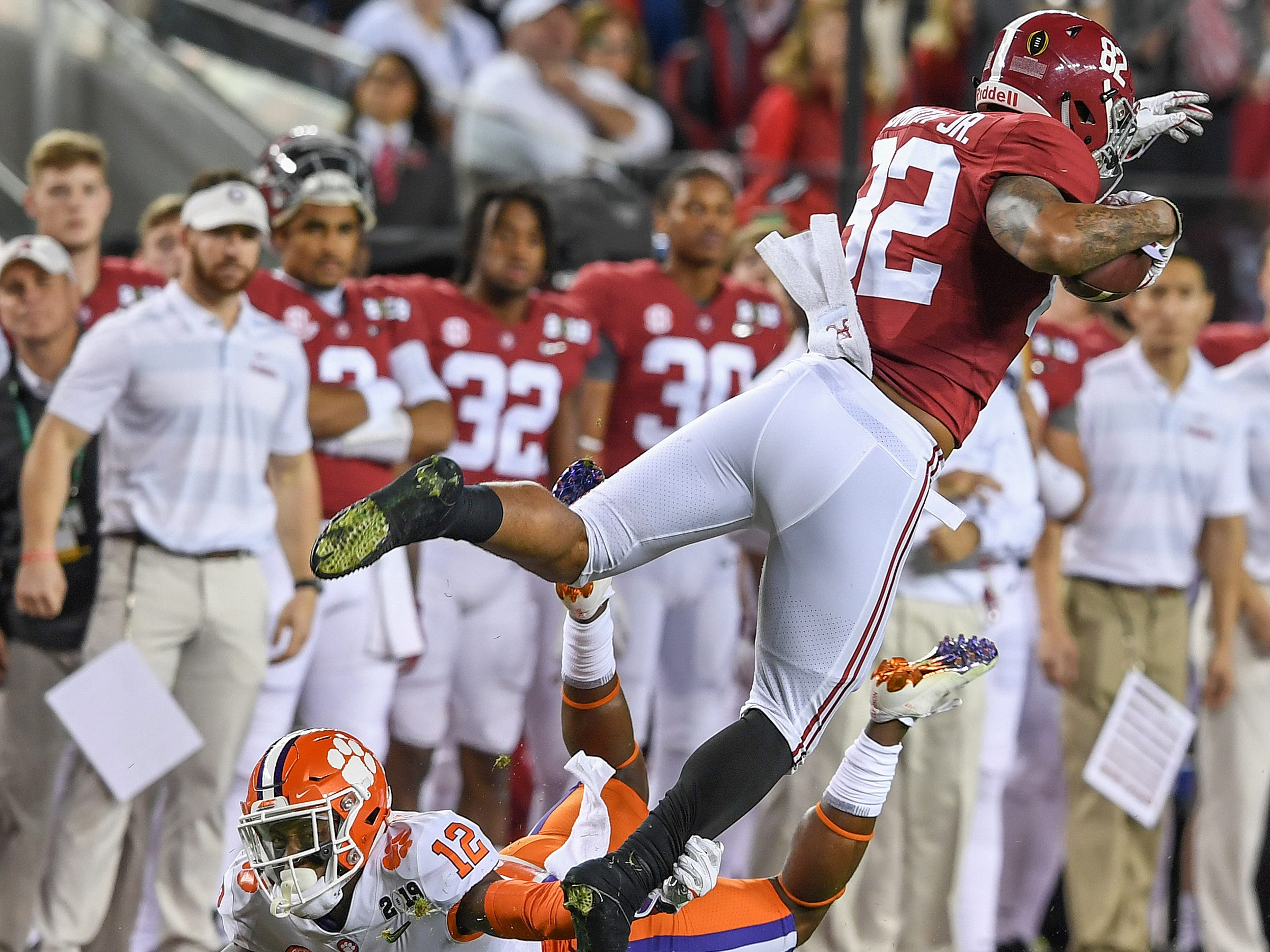 Clemson defensive back K'Von Wallace (12) brings down Alabama tight end Irv Smith Jr. (82) during the 1st quarter of the College Football National Championship at Levi's Stadium in Santa Clara, CA Monday, January 7, 2019.