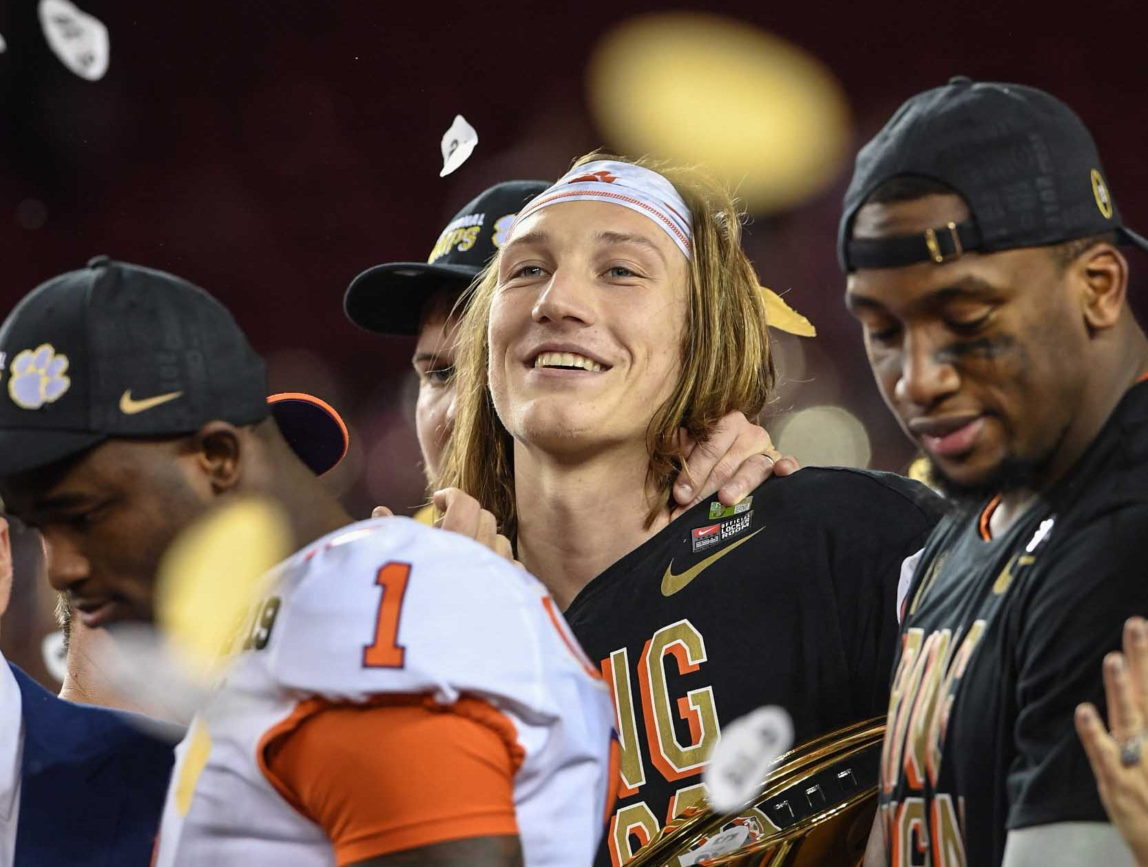 Clemson quarterback Trevor Lawrence (16), middle, cornerback Trayvon Mullen (1), left, and defensive lineman Clelin Ferrell (99) celebrate a 44-16 win over Alabama after the College Football Championship game at Levi's Stadium in Santa Clara, California Monday, January 7, 2019.