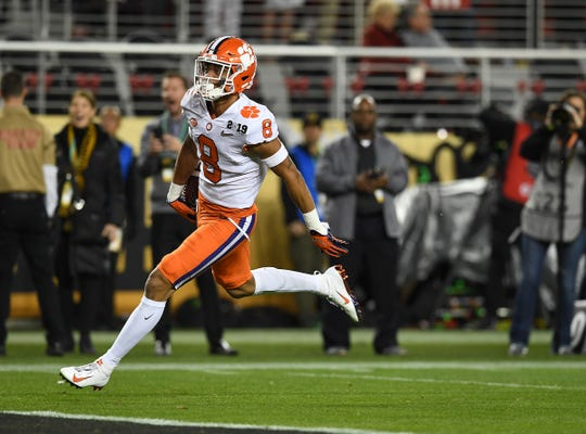Clemson defensive back A.J. Terrell (8) returns an interception to score against Alabama during the 1st quarter of the College Football National Championship at Levi's Stadium in Santa Clara, CA Monday, January 7, 2019.