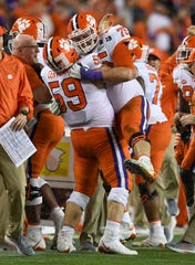 Clemson offensive lineman Gage Cervenka (59), left, celebrates with offensive lineman Mitch Hyatt (75) late in the 2nd half of their College Football National Championship game against Alabama at Levi's Stadium in Santa Clara, CA Monday, January 7, 2019. Clemson defeated Alabama 44-16.