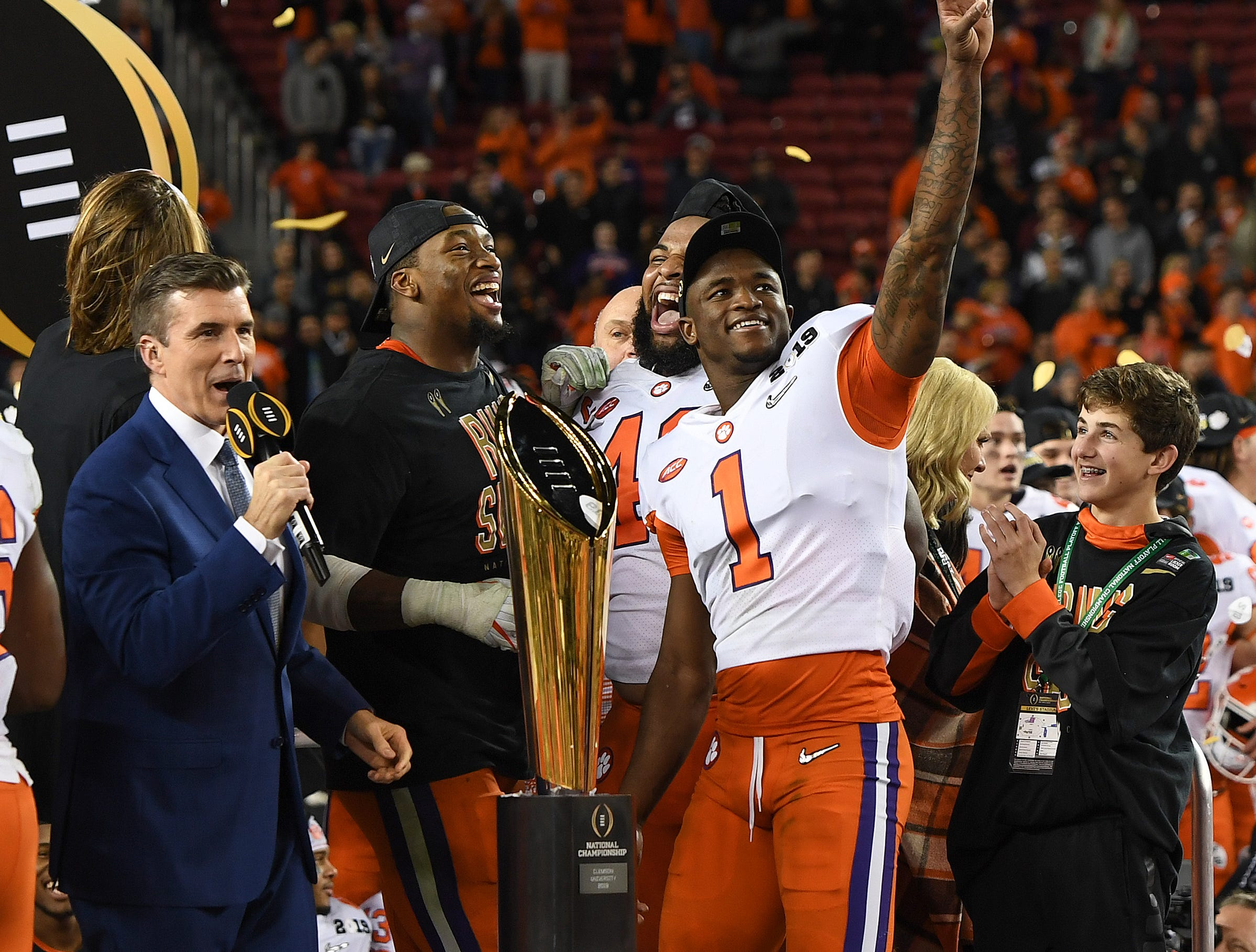 Clemson defensive lineman Christian Wilkins (42), defensive lineman Clelin Ferrell (99), and cornerback Trayvon Mullen (1) celebrate their 44-16 win over Alabama in the College Football National Championship at Levi's Stadium in Santa Clara, CA Monday, January 7, 2019.