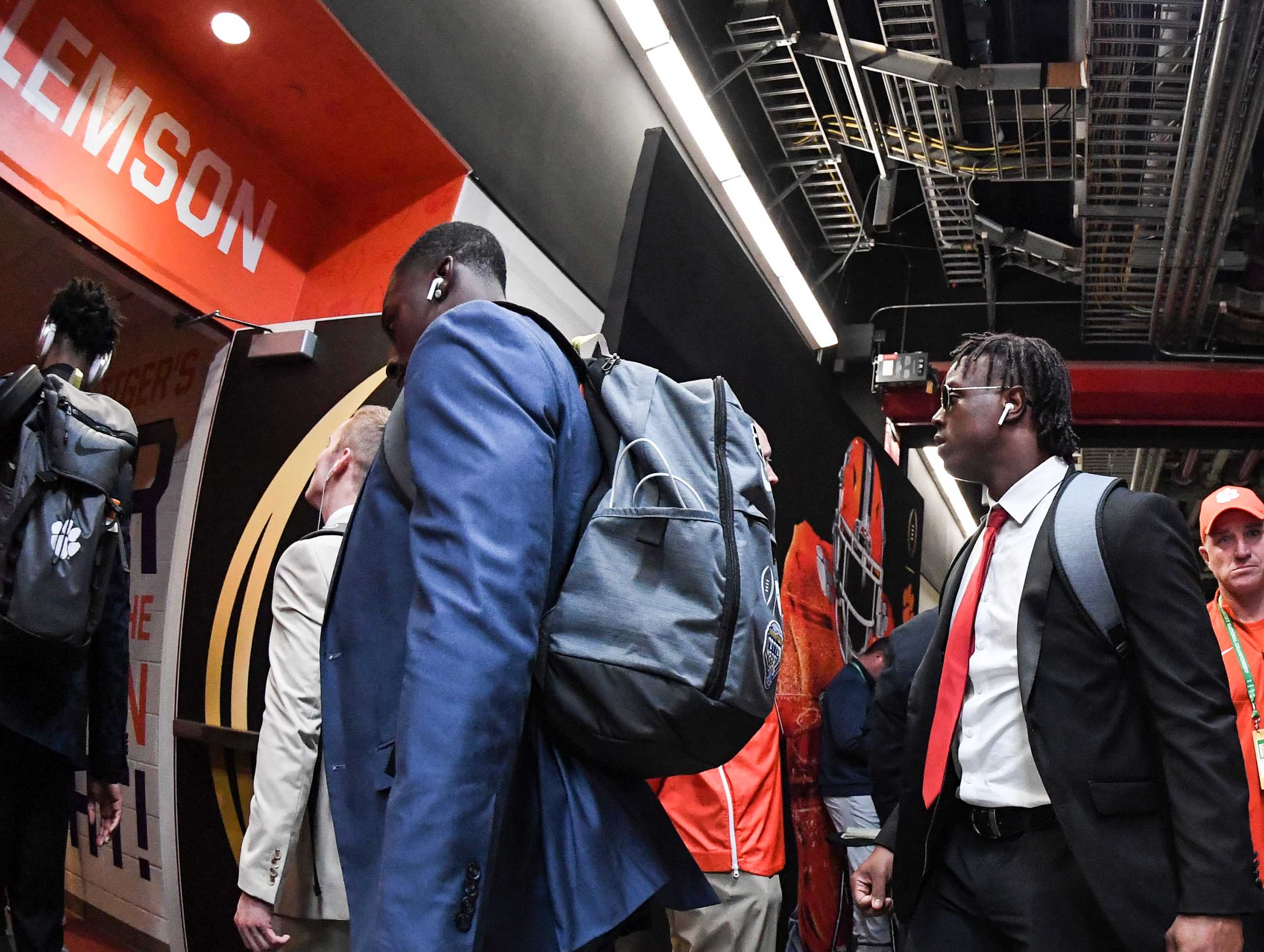 Clemson running back Travis Etienne (9) and teammates arrive before kickoff at Levi's Stadium in Santa Clara, California Monday, January 7, 2019.