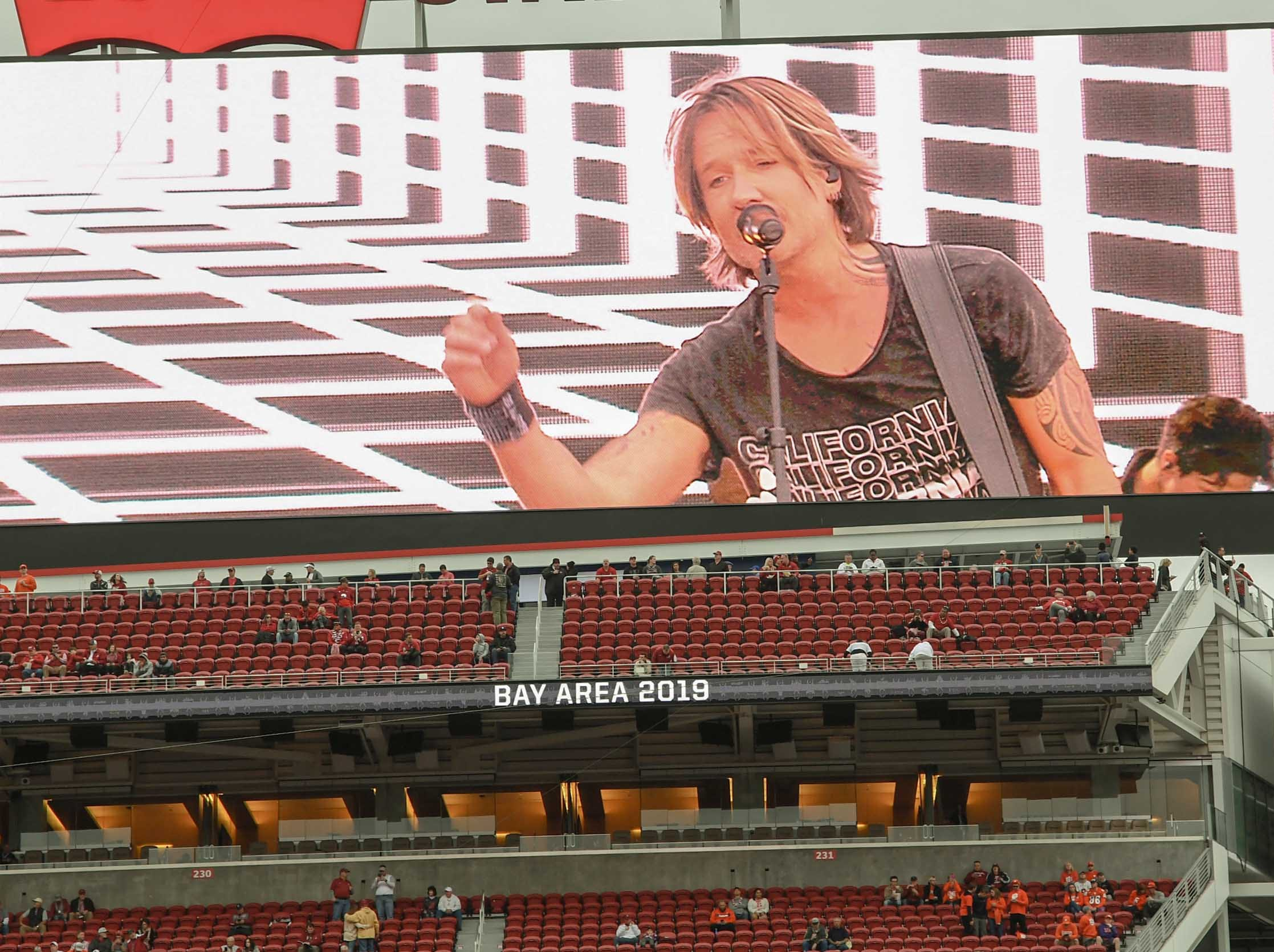 Keith Urban is shown on a large video screen before kickoff at Levi's Stadium in Santa Clara, California Monday, January 7, 2019.