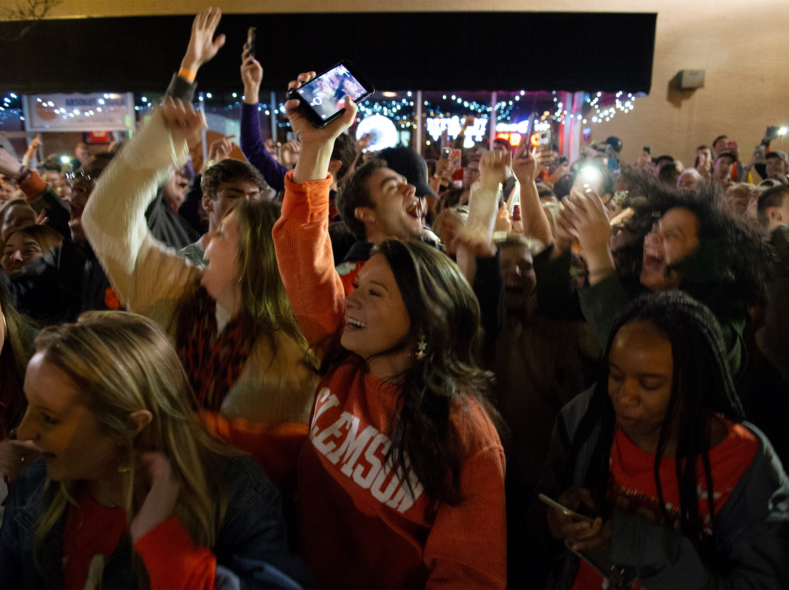 Clemson fans celebrate Clemson's win in the College Football Playoff National Championship Monday, Jan. 7, 2019. Thousands of fans attended the match party on College Avenue in Clemson.