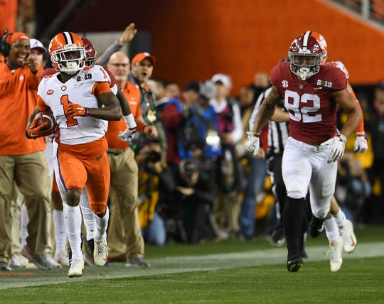 Clemson cornerback Trayvon Mullen (1) returns an interception against Alabama during the 2nd quarter of the College Football National Championship at Levi's Stadium in Santa Clara, CA Monday, January 7, 2019.