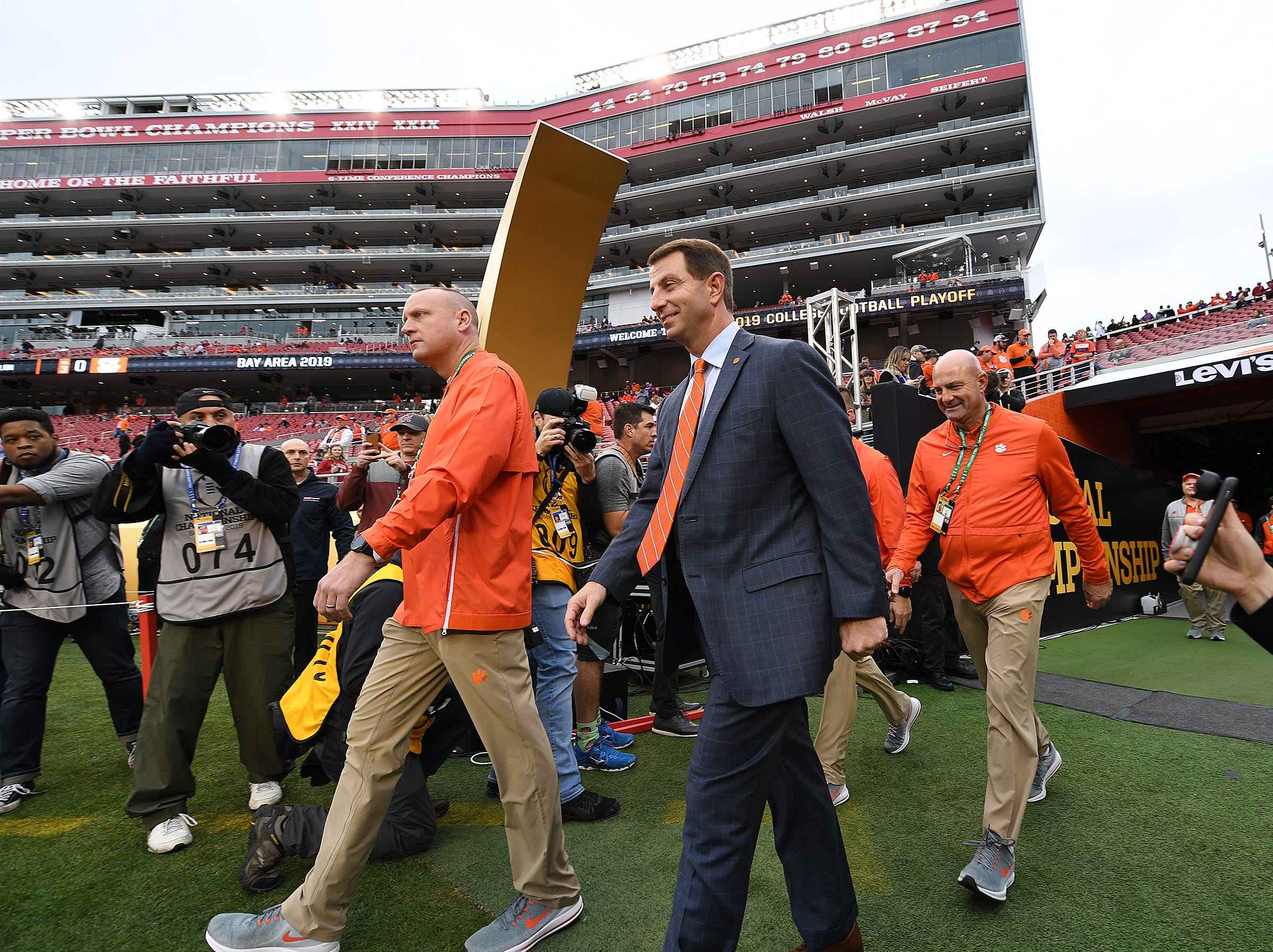 Clemson head coach Dabo Swinney walks to the filed at Levi's Stadium in Santa Clara, CA Monday, January 7, 2019 after the team arrived for their game against Alabama in the College Football National Championship.