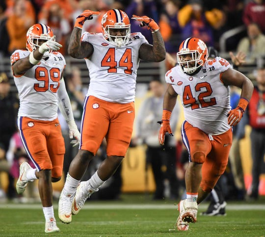 Clemson defensive tackle Nyles Pinckney (44) celebrates with defensive lineman Clelin Ferrell (99) and defensive lineman Christian Wilkins (42) stopping Alabama quarterback Mac Jones (10) on a fake field goal attempt during the third quarter of the College Football Championship at Levi's Stadium in Santa Clara, California Monday, January 7, 2019.