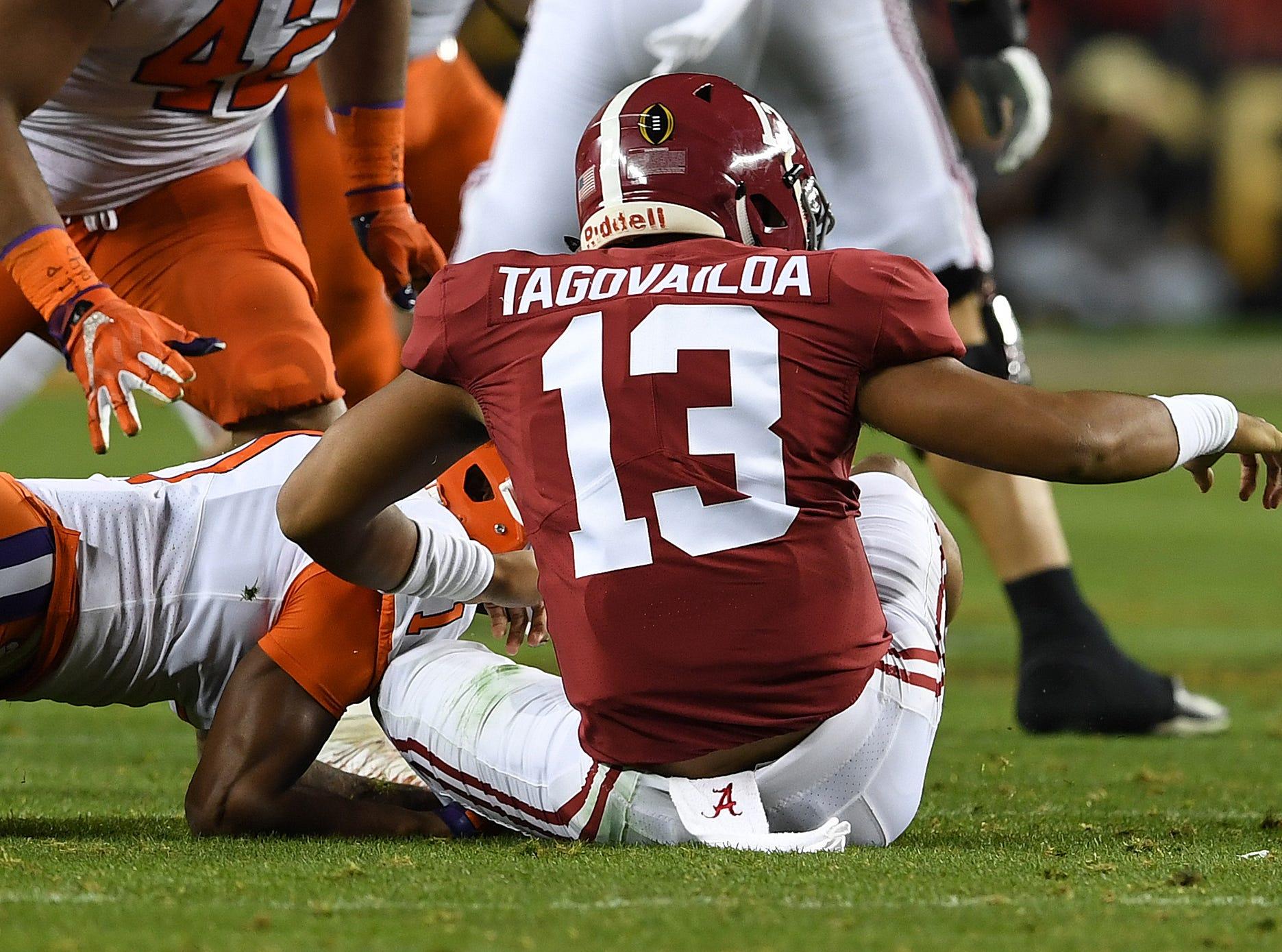 Clemson cornerback Trayvon Mullen (1)  forces a fumble by Alabama quarterback Tua Tagovailoa (13) during the 2nd quarter of the College Football National Championship at Levi's Stadium in Santa Clara, CA Monday, January 7, 2019.