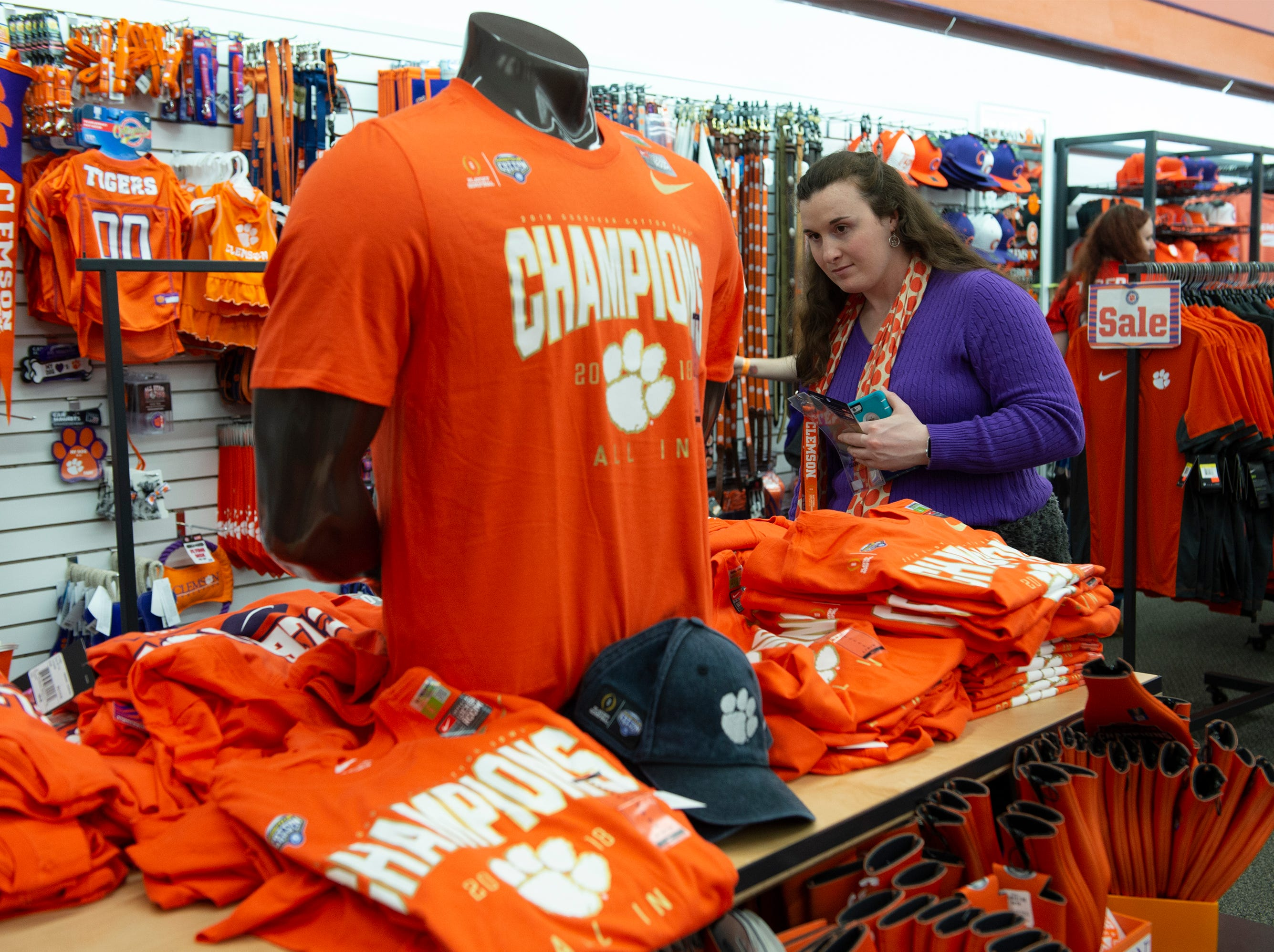 Recent Clemson graduate Kayla Crider shops for championship merchandise at The Tiger Sports Shop on College Avenue after Clemson defeated Alabama in the College Football Playoff National Championship Monday, Jan. 7, 2019.