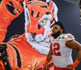 Christian Wilkins says staying another year was worth it