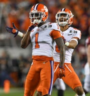 Clemson cornerback Trayvon Mullen (1) celebrates with defensive back A.J. Terrell (8) after an interception against Alabama during the 2nd quarter of the College Football National Championship at Levi's Stadium in Santa Clara, CA Monday, January 7, 2019.