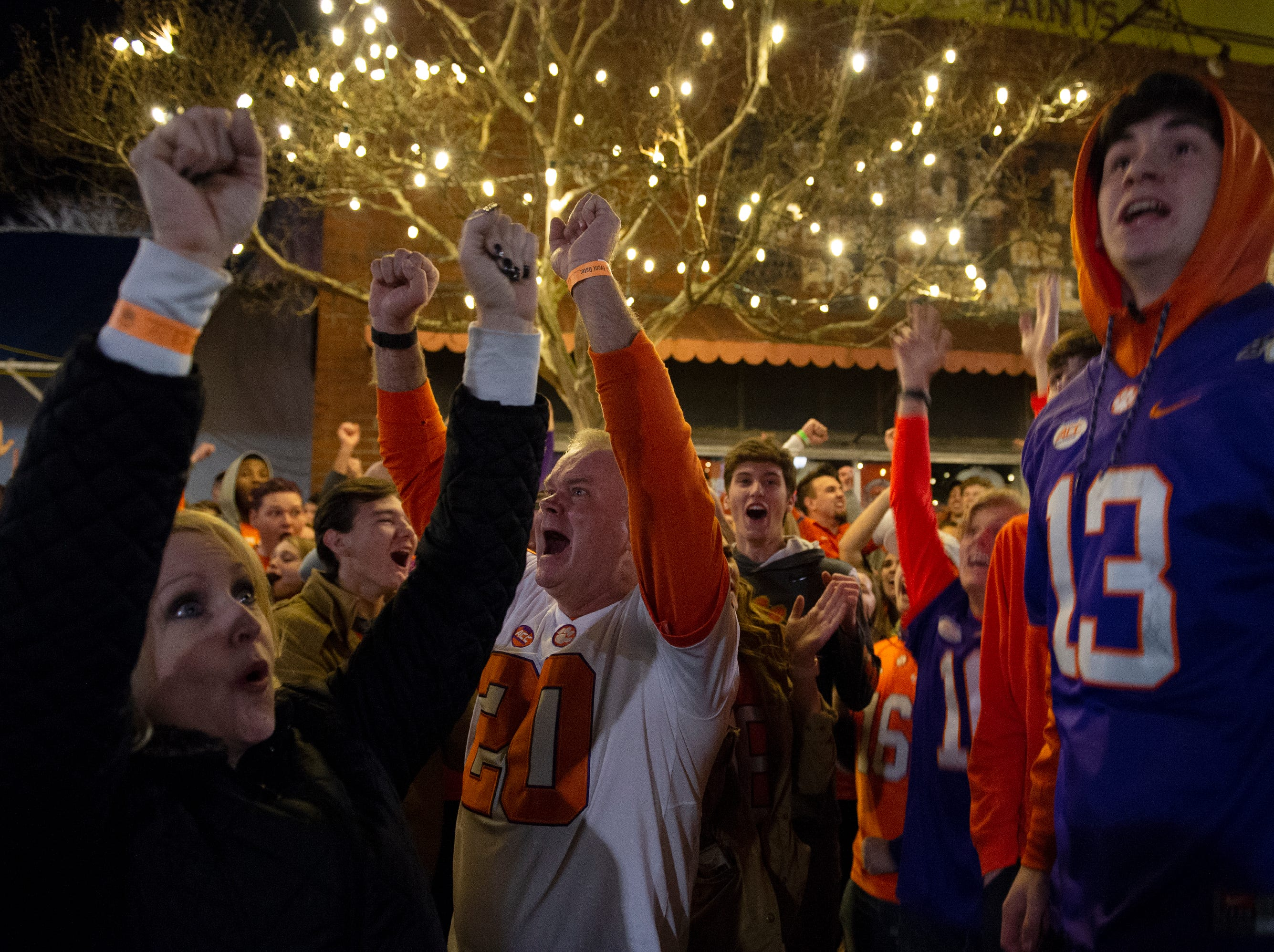From left, Stephanie Cozzi, Steve Cozzi, and Jake George celebrate a Clemson touchdown while watching Clemson play Alabama in the College Football Playoff National Championship Monday, Jan. 7, 2019. Steve and Stephanie Cozzi travelled from New Jersey to watch the game with their daughter Samantha, a junior. George is a freshman.