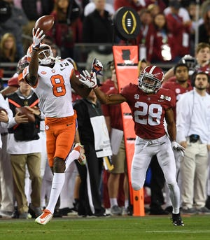Clemson wide receiver Justyn Ross (8) makes a one handed catch past Alabama defensive back Josh Jobe (28) during the 3rd quarter of the College Football National Championship at Levi's Stadium in Santa Clara, CA Monday, January 7, 2019.