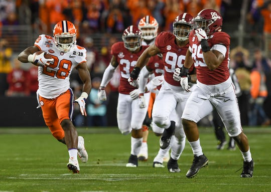 Clemson running back Tavien Feaster (28) carries against Alabama during the 2nd quarter of the College Football National Championship at Levi's Stadium in Santa Clara, CA Monday, January 7, 2019.