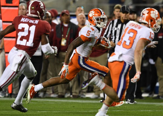 Clemson wide receiver Tee Higgins (5) carries after a reception against Alabama during the 2nd quarter of the College Football National Championship at Levi's Stadium in Santa Clara, CA Monday, January 7, 2019.