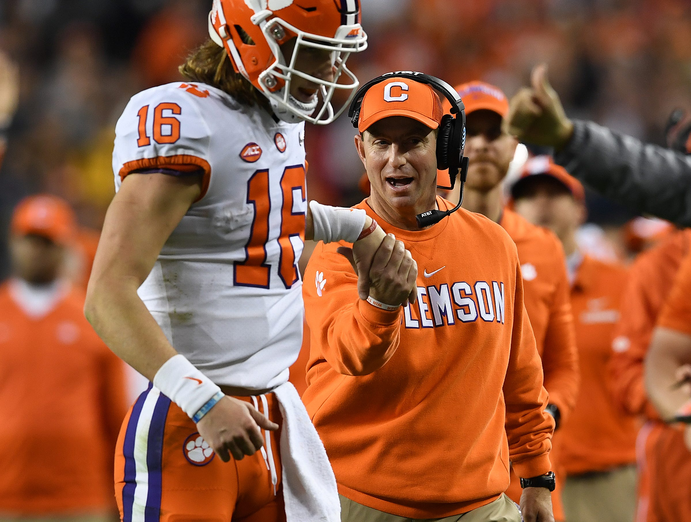 Clemson head coach Dabo Swinney congratulates quarterback Trevor Lawrence (16) after the Tigers scored against Alabama during the 3rd quarter of the College Football National Championship at Levi's Stadium in Santa Clara, CA Monday, January 7, 2019.