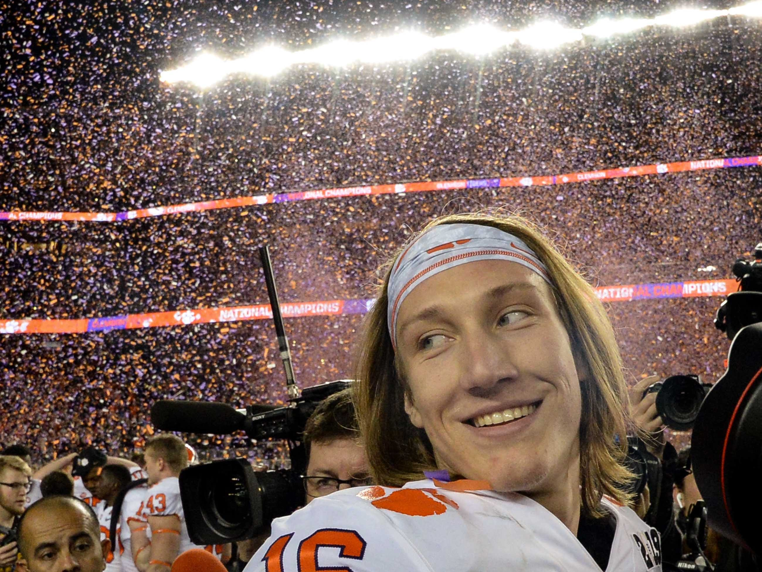 Clemson quarterback Trevor Lawrence (16) celebrates beating Alabama 44-16 after the College Football Championship game at Levi's Stadium in Santa Clara, California Monday, January 7, 2019.
