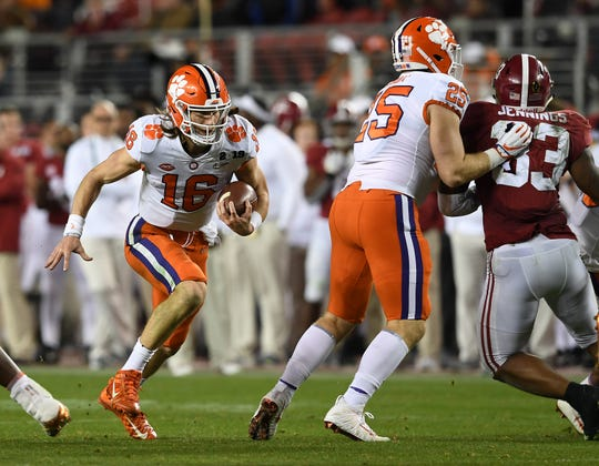 Clemson quarterback Trevor Lawrence (16) carries against Alabama during the 2nd half of the College Football National Championship at Levi's Stadium in Santa Clara, CA Monday, January 7, 2019.