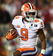 Clemson running back Travis Etienne (9) scores against Alabama during the 2nd quarter of the College Football National Championship at Levi's Stadium in Santa Clara, CA Monday, January 7, 2019.