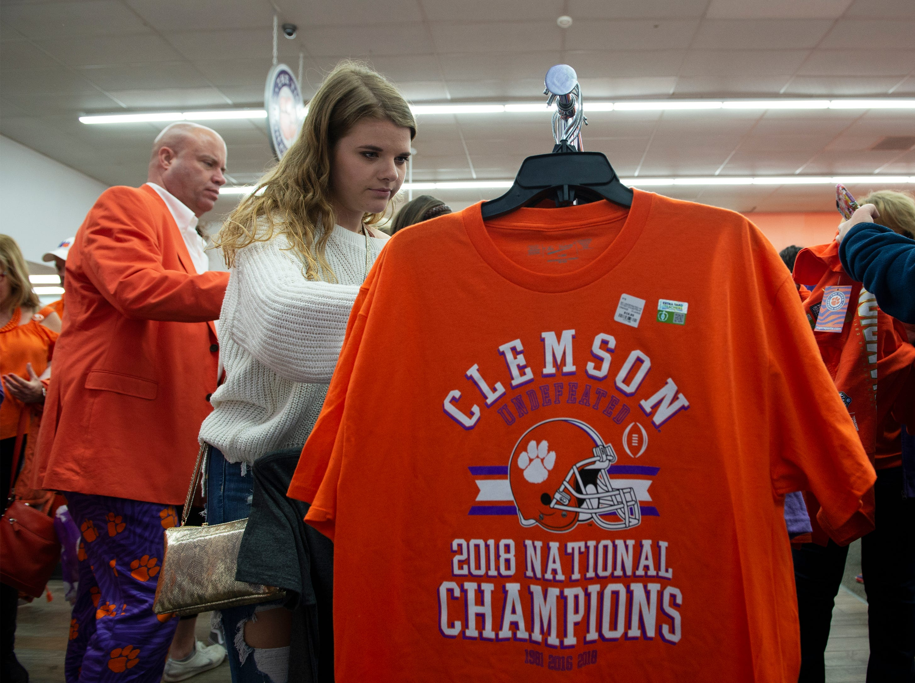 Haley Yablonowski, a sophomore, shops for championship merchandise at The Tiger Sports Shop on College Avenue after Clemson defeated Alabama in the College Football Playoff National Championship Monday, Jan. 7, 2019.