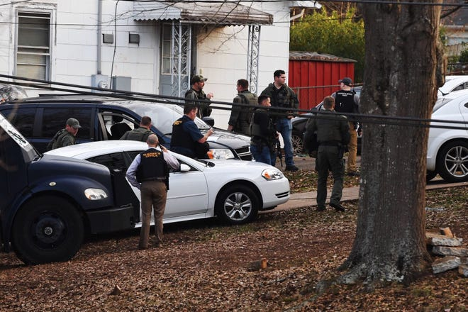 Greenville County SWAT team members surround a home on Pine Grove Lane as they respond to a barricade situation Tuesday afternoon, Jan. 8, 2019.