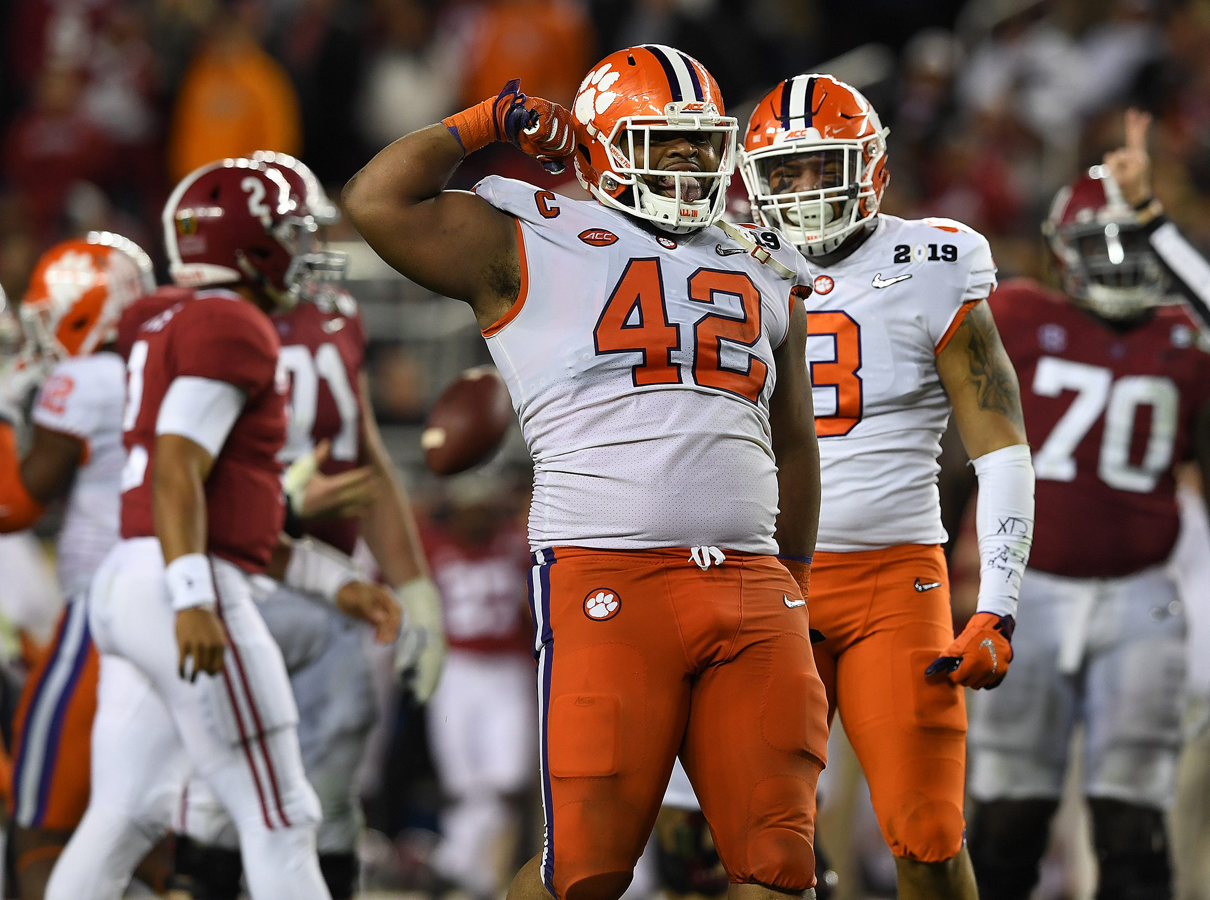 Clemson defensive lineman Christian Wilkins (42) reacts after stopping Alabama quarterback Jalen Hurts (2) during the 2nd half of the College Football National Championship at Levi's Stadium in Santa Clara, CA Monday, January 7, 2019.