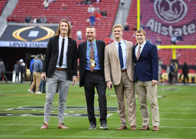 Clemson quarterbacks coach Brandon Streeter, second from left, poses with his quarterbacks, from left, Trevor Lawrence, Chase Brice, and Ben Batson on the filed at Levi's Stadium in Santa Clara, CA Monday, January 7, 2019 after the team arrived for their game against Alabama in the College Football National Championship.